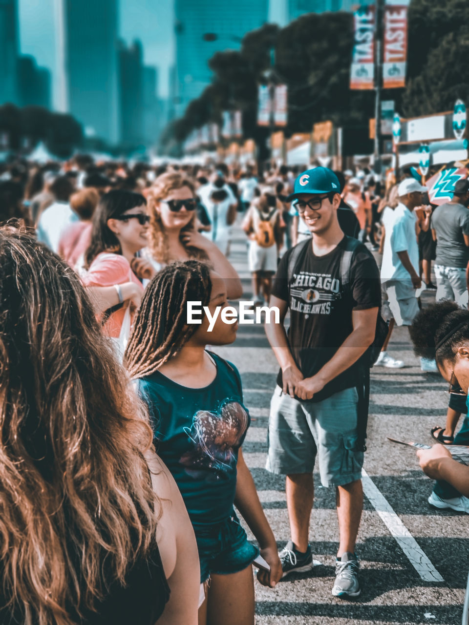 real people, crowd, city, group of people, large group of people, architecture, street, men, lifestyles, women, leisure activity, togetherness, day, adult, casual clothing, built structure, outdoors, building exterior, standing, hairstyle, festival