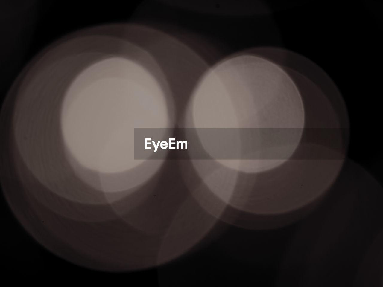 circle, no people, close-up, illuminated, indoors, night, black background