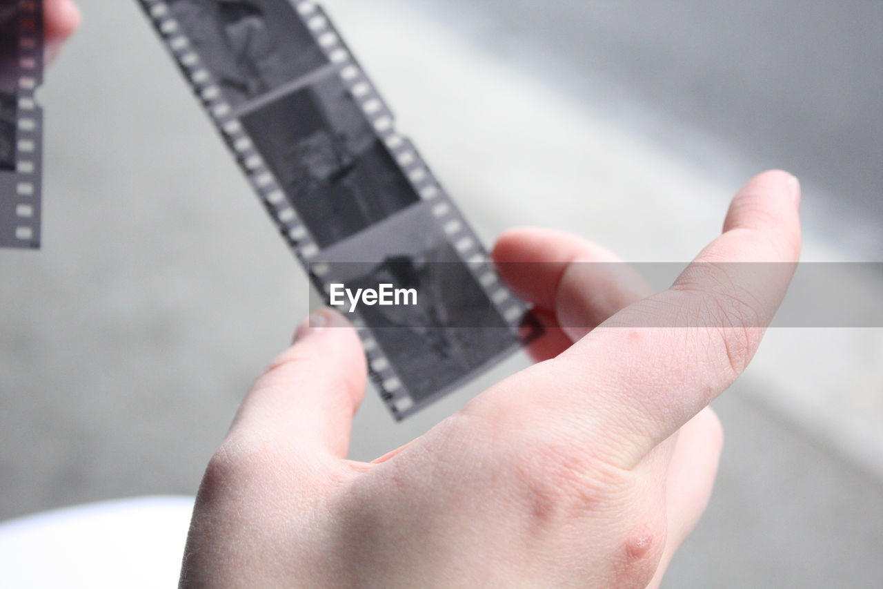Cropped image of hand holding film reel