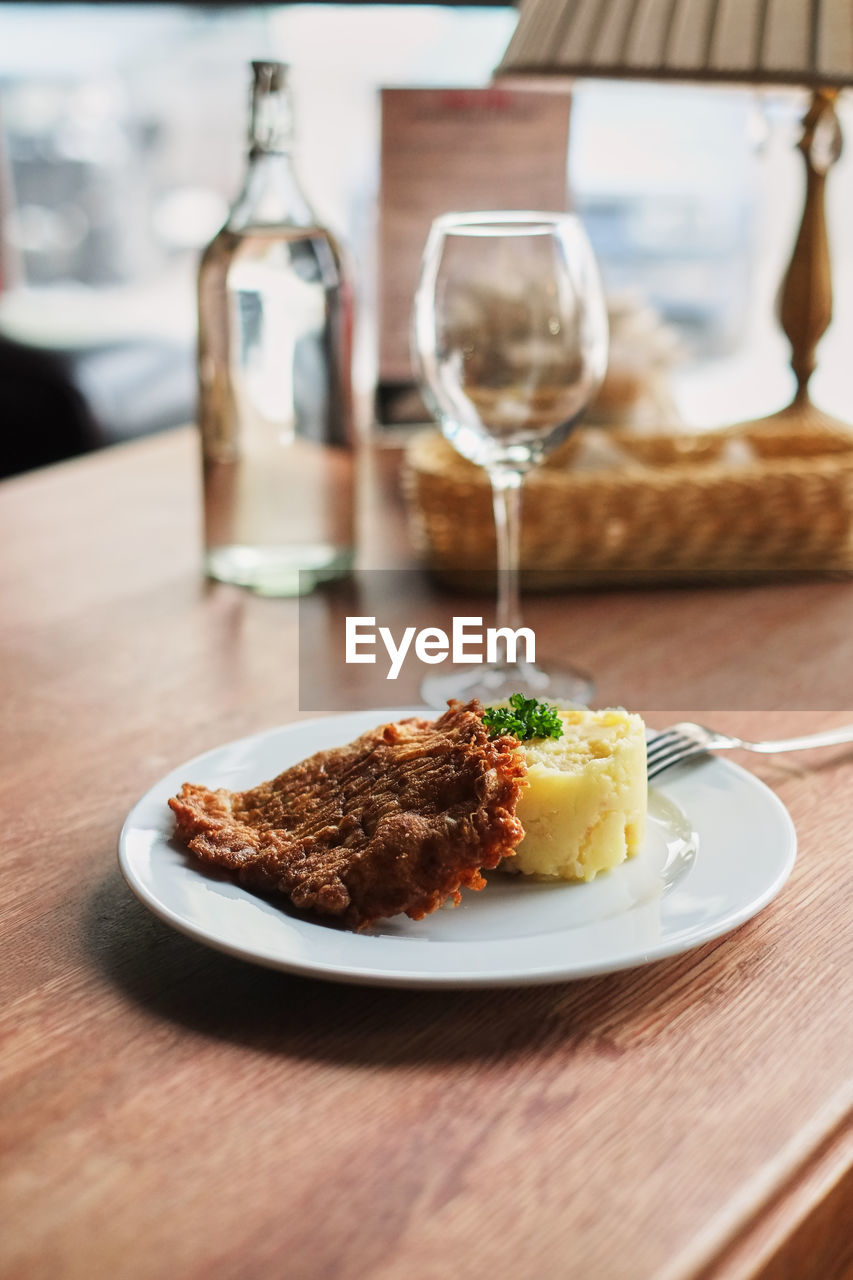 table, food and drink, food, plate, ready-to-eat, freshness, still life, glass, drink, serving size, indoors, refreshment, wineglass, no people, close-up, focus on foreground, household equipment, alcohol, drinking glass, wine, meal, temptation, dinner
