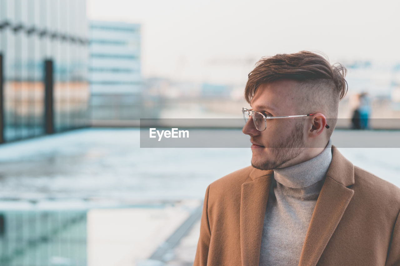 Man Looking Away While Wearing Eyeglasses