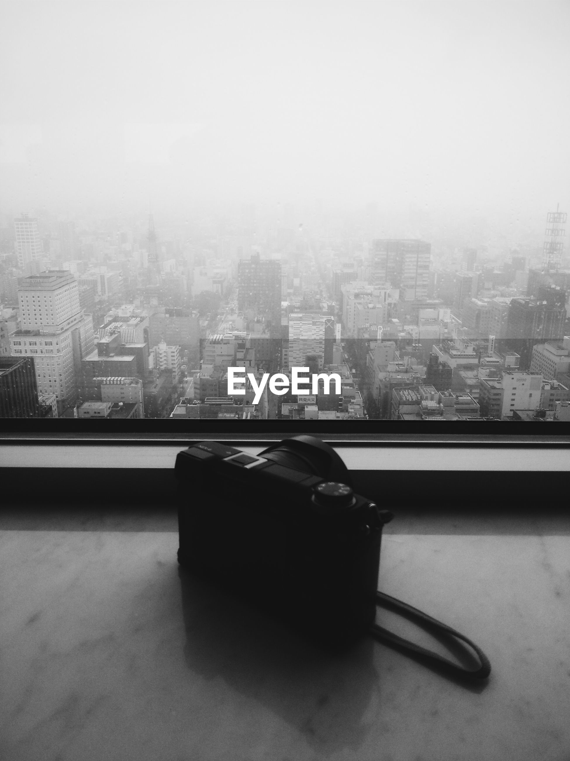 Camera on window sill overlooking cityscape