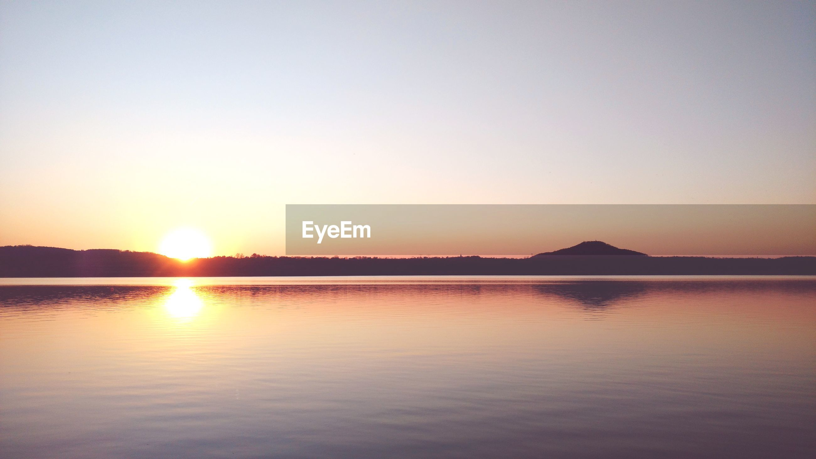 SCENIC VIEW OF SUNSET OVER MOUNTAINS AGAINST SKY