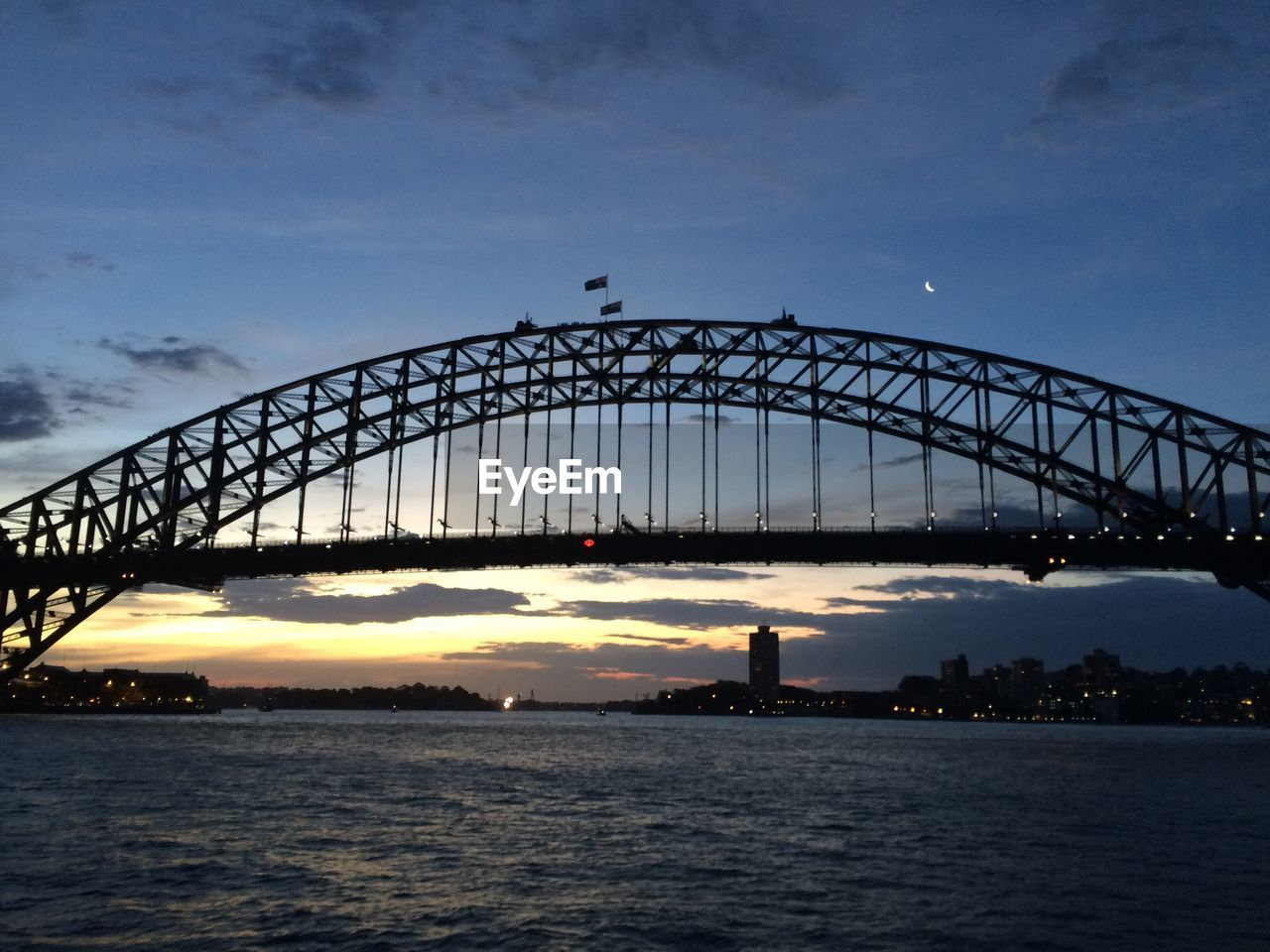 bridge - man made structure, connection, sunset, sky, built structure, architecture, river, water, dusk, transportation, outdoors, cloud - sky, silhouette, no people, travel destinations, nature, city, day