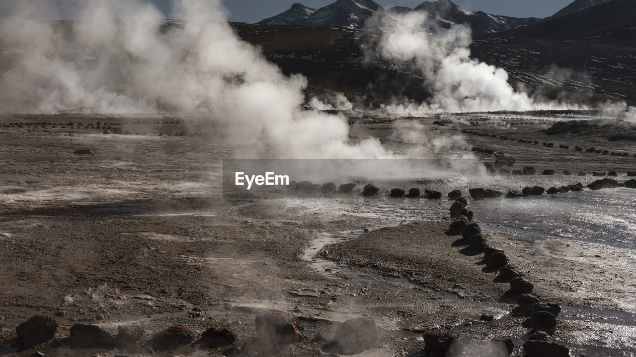 landscape, steam, environment, beauty in nature, nature, non-urban scene, geology, smoke - physical structure, scenics - nature, hot spring, day, power in nature, physical geography, water, no people, heat - temperature, tourism, high angle view, travel, mountain, outdoors