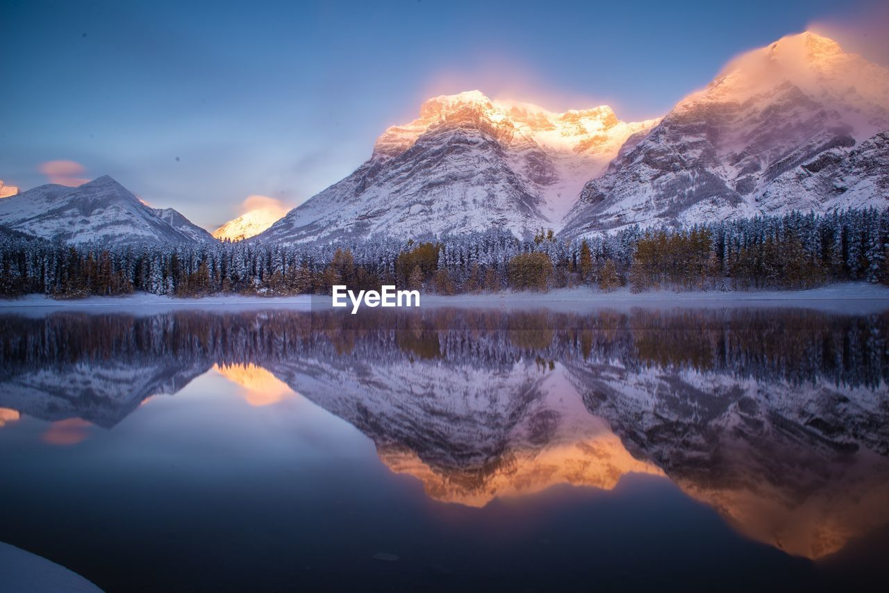 scenics - nature, water, lake, beauty in nature, reflection, sky, tranquil scene, mountain, tranquility, idyllic, sunset, waterfront, cloud - sky, nature, non-urban scene, no people, cold temperature, symmetry, mountain range, outdoors, reflection lake, snowcapped mountain