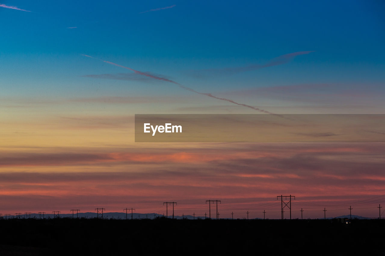 sunset, sky, cloud - sky, orange color, beauty in nature, scenics - nature, silhouette, no people, nature, environment, tranquil scene, tranquility, landscape, fuel and power generation, technology, outdoors, electricity, idyllic, non-urban scene, dramatic sky, power supply, romantic sky