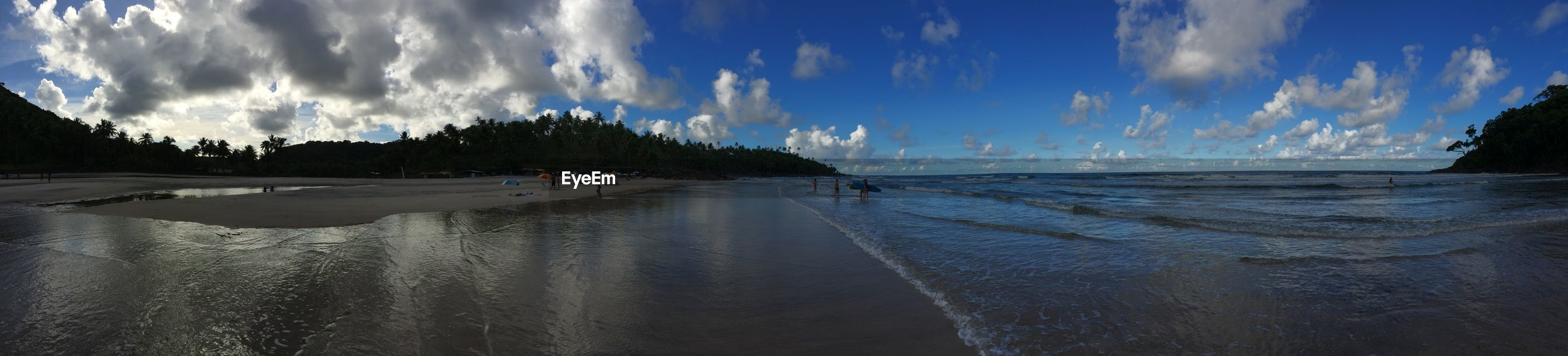Panoramic view of beach at dusk