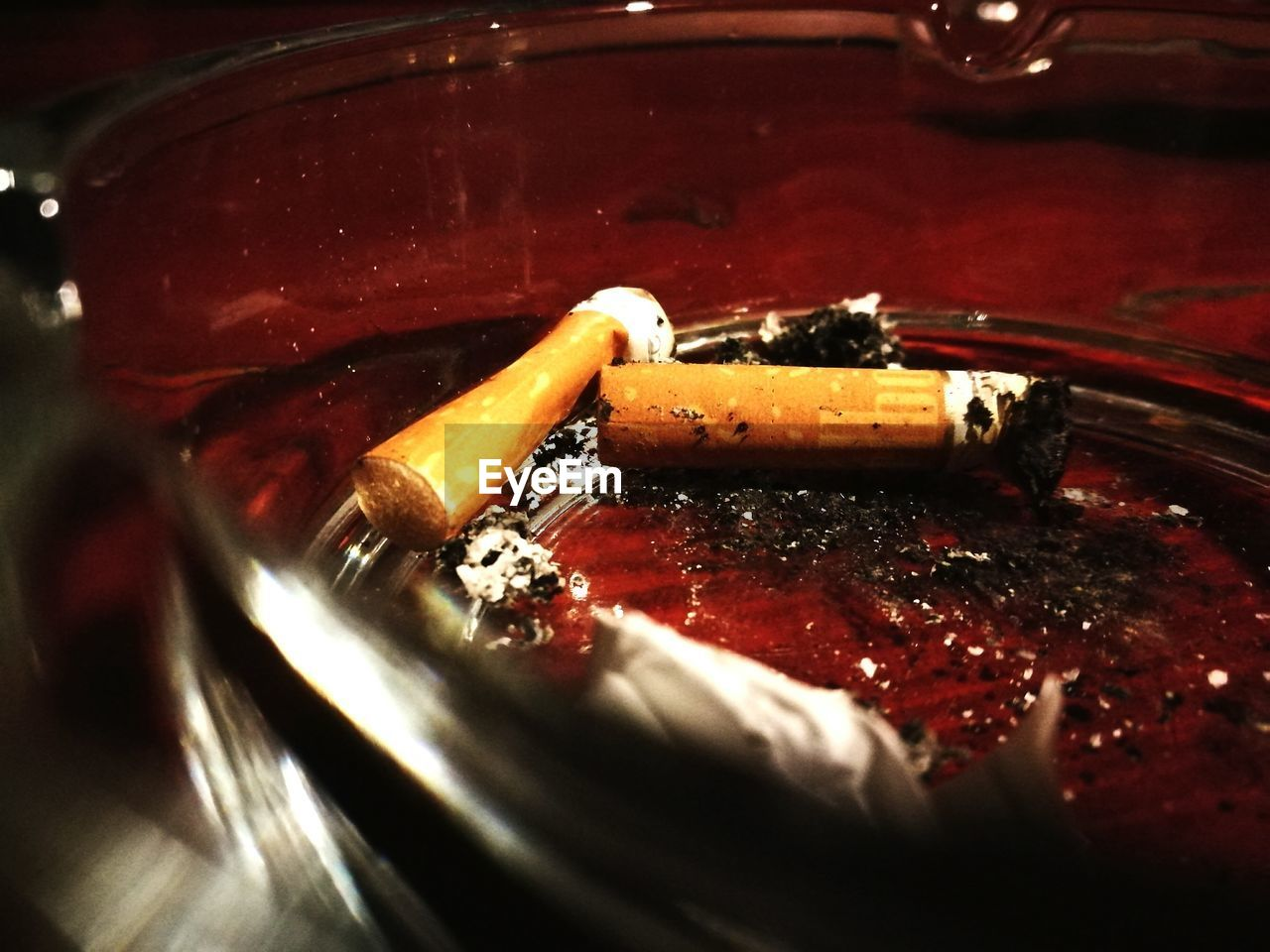 bad habit, addiction, smoking issues, cigarette, cigarette butt, ashtray, danger, close-up, ash, risk, social issues, table, indoors, no people, red, day