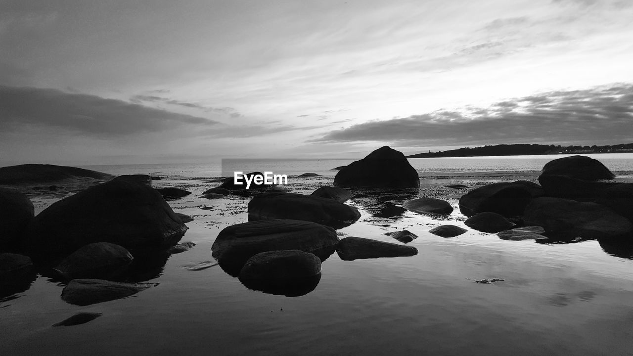 water, sky, sea, beach, nature, beauty in nature, rock - object, tranquil scene, tranquility, scenics, cloud - sky, outdoors, horizon over water, sunset, day, no people