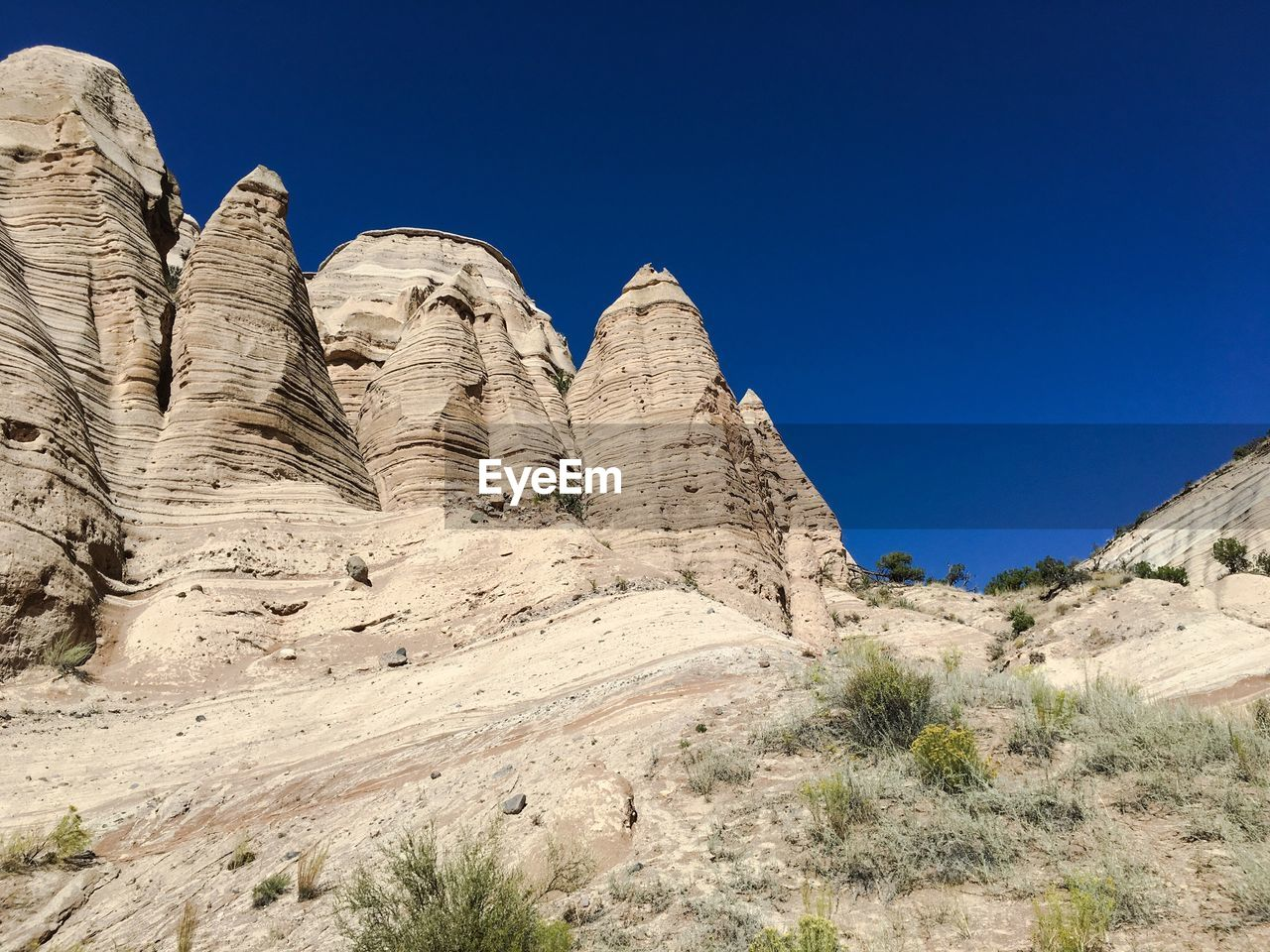 Low Angle View Of Rock Formations At Kasha-Katuwe Tent Rocks National Monument Against Clear Blue Sky