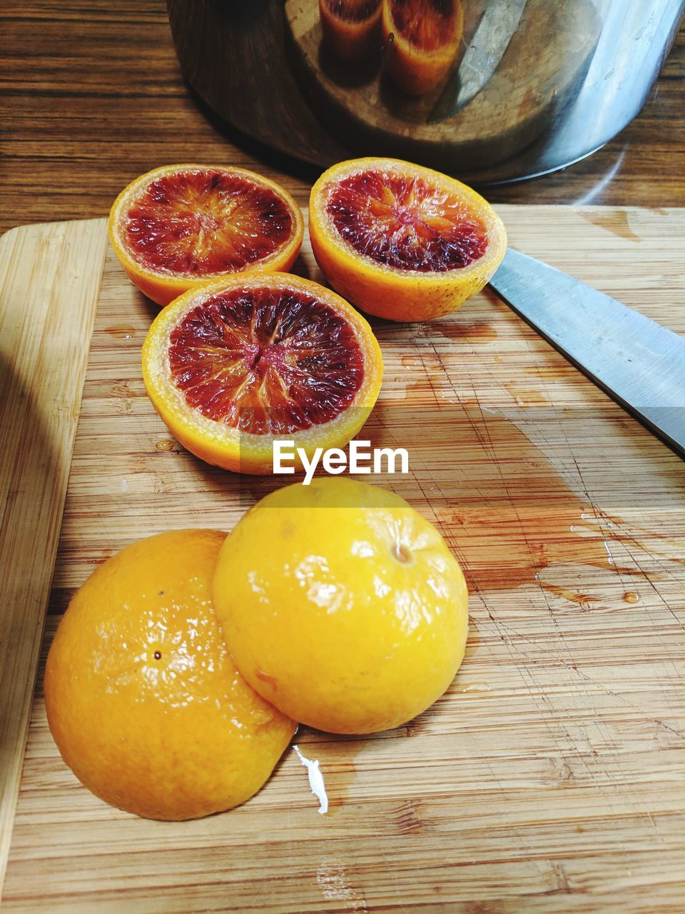 fruit, healthy eating, citrus fruit, cross section, freshness, food and drink, food, table, halved, wood - material, no people, slice, indoors, high angle view, cutting board, day, blood orange, close-up