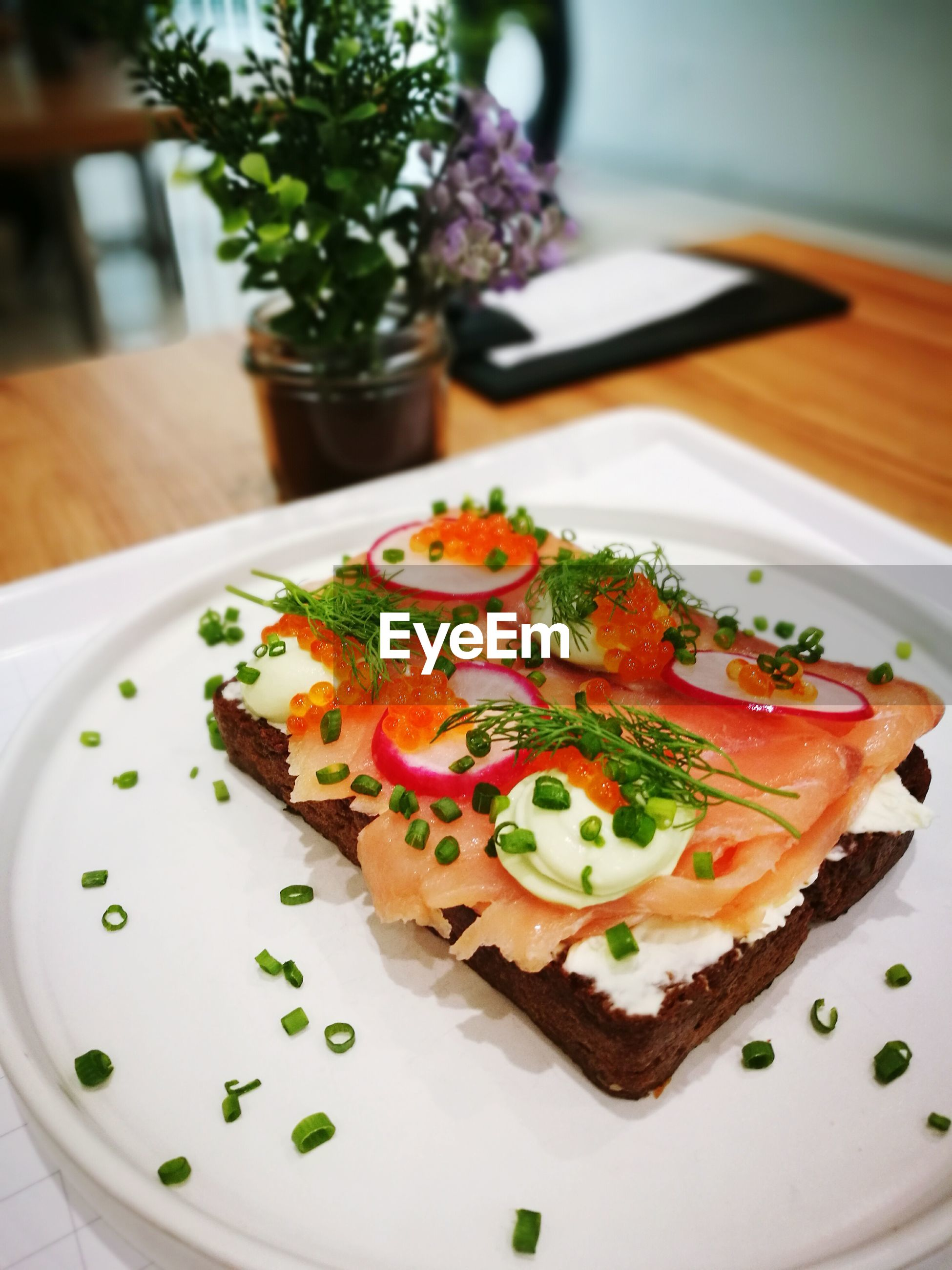High angle view of open faced sandwich in plate on table