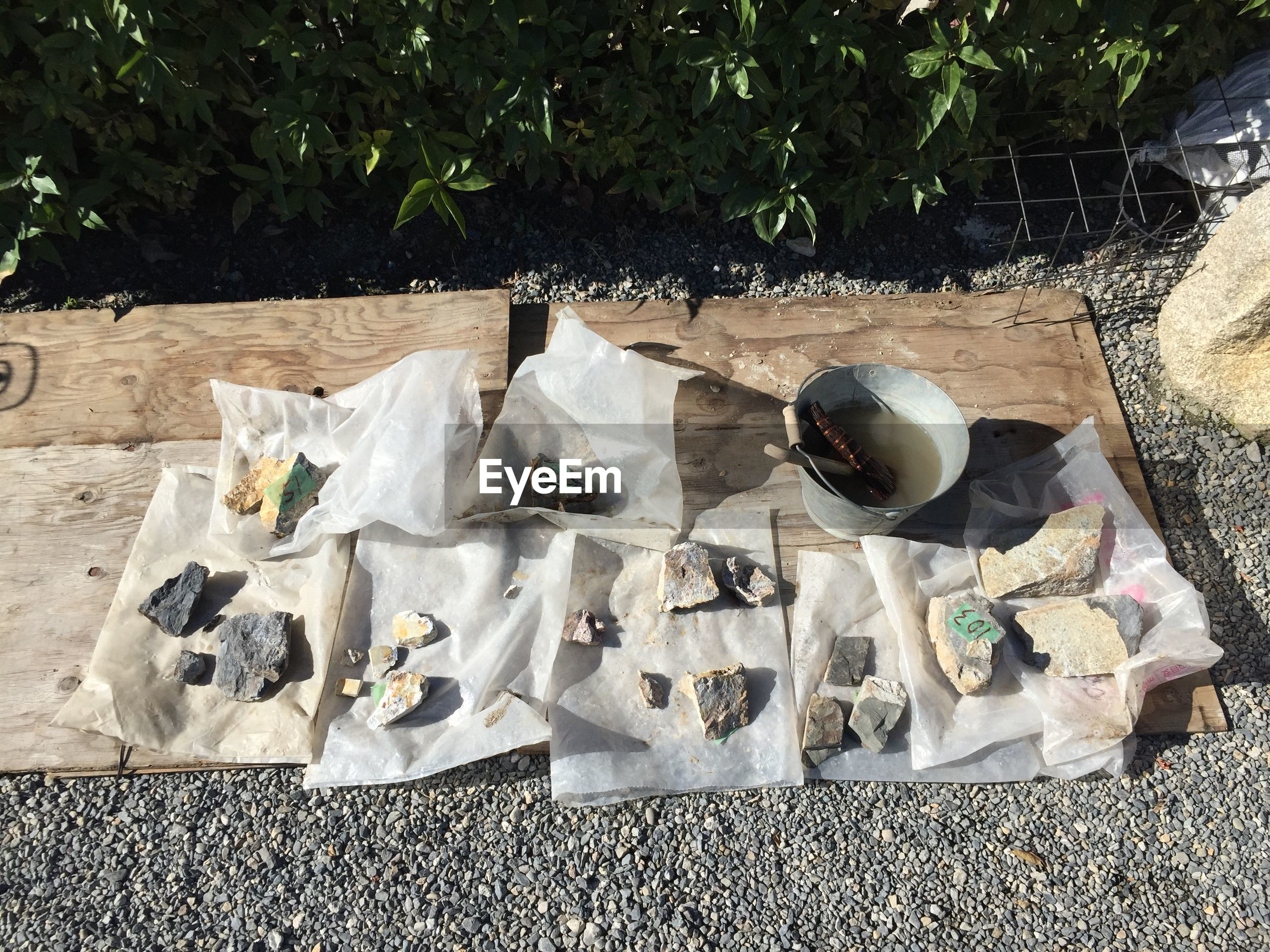 High angle view of stones on plastic