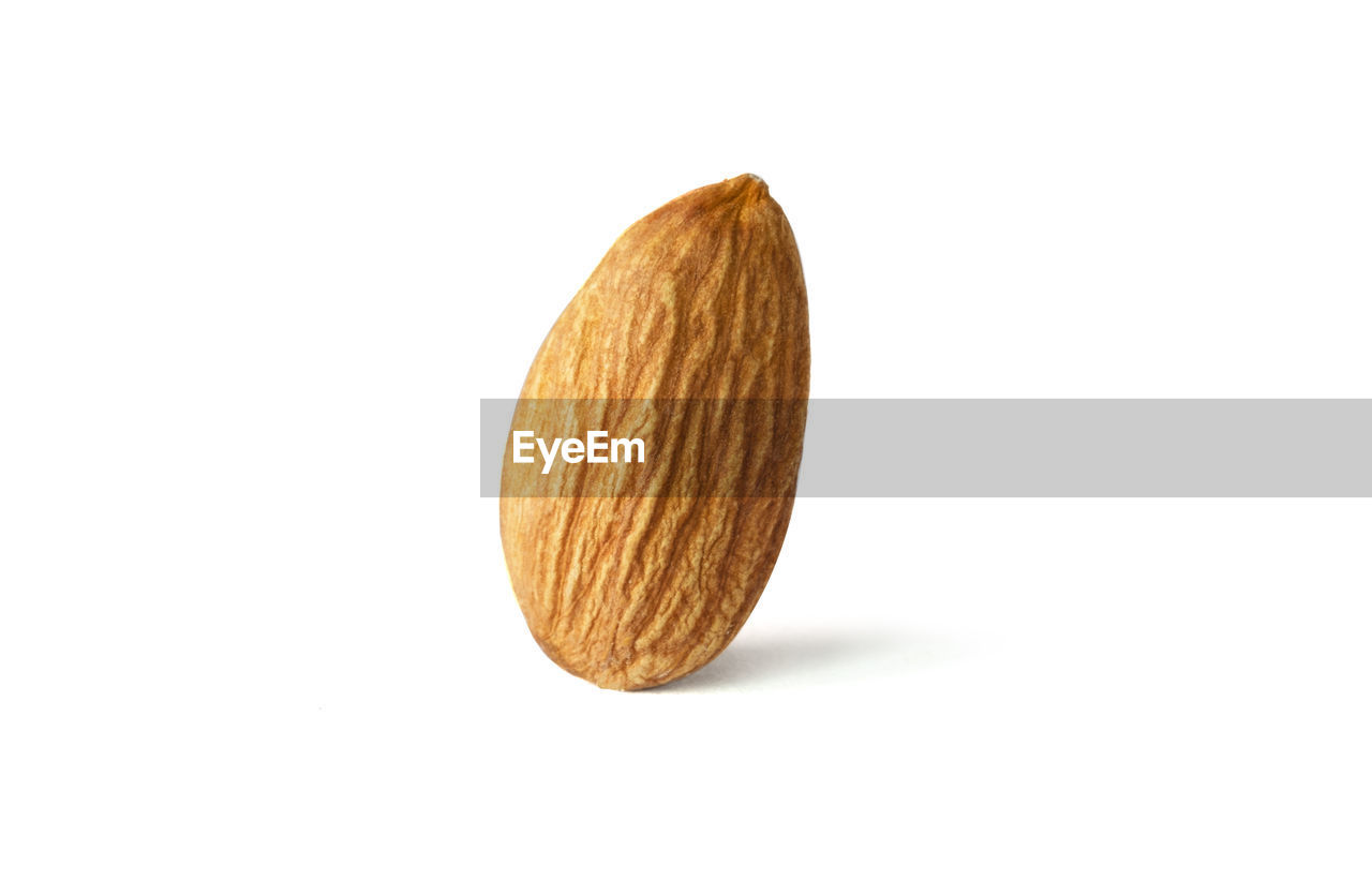 studio shot, white background, still life, indoors, close-up, food, no people, food and drink, copy space, freshness, single object, brown, cut out, wellbeing, healthy eating, nut - food, nut, wood - material, raw food, almond, snack