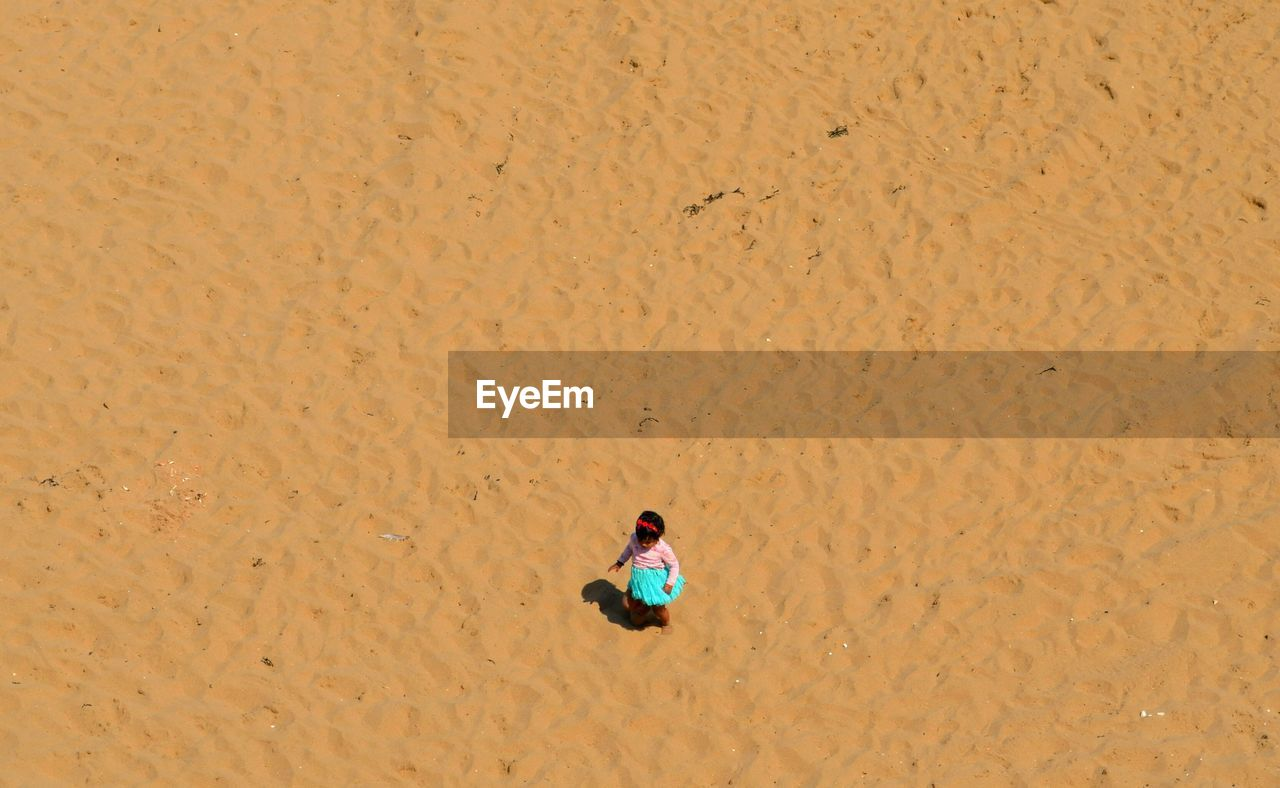 sand, high angle view, one person, beach, one man only, people, adults only, adult, day, nature, outdoors, only men
