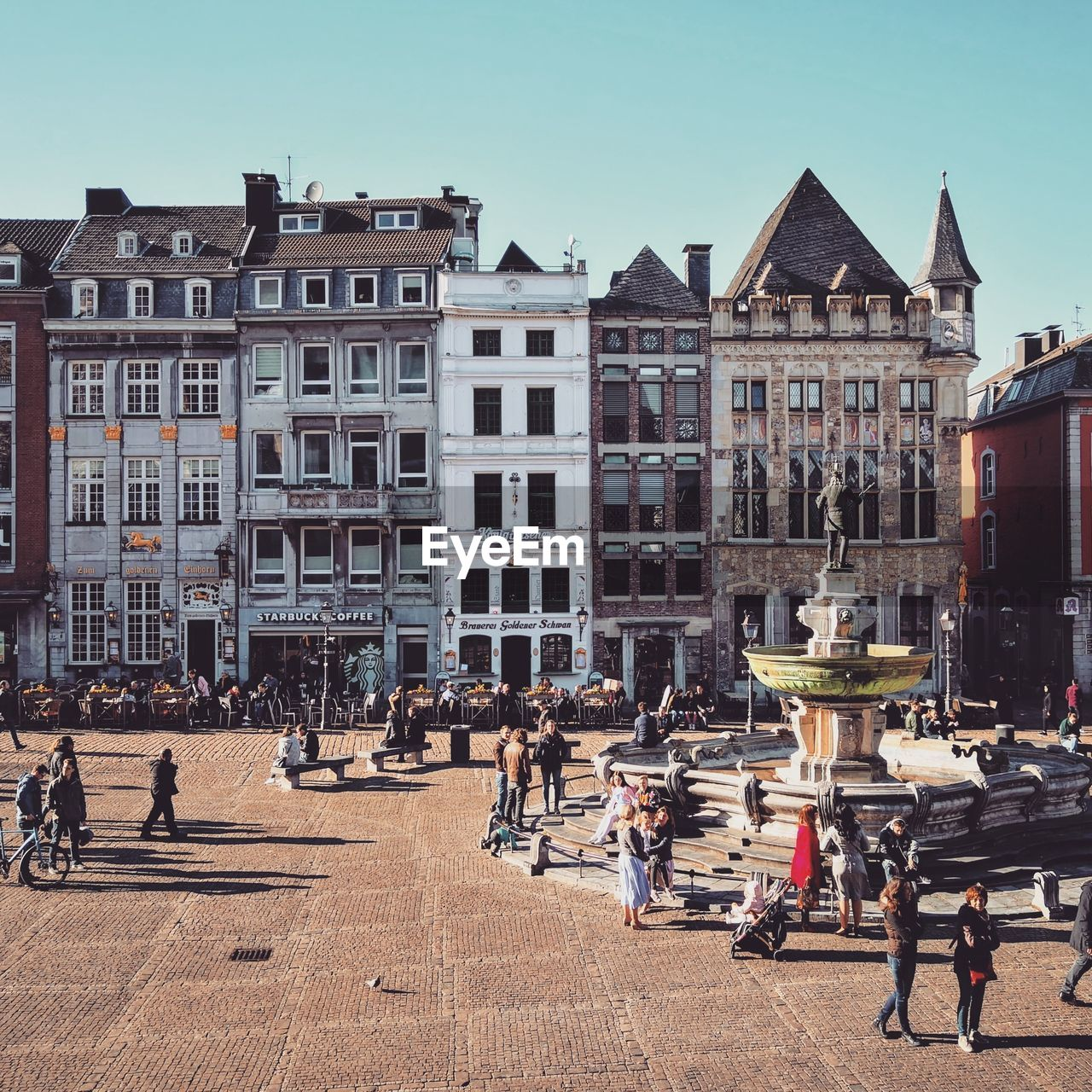 building exterior, architecture, built structure, group of people, crowd, large group of people, real people, building, city, street, women, men, sky, day, nature, clear sky, residential district, adult, city life, lifestyles, outdoors