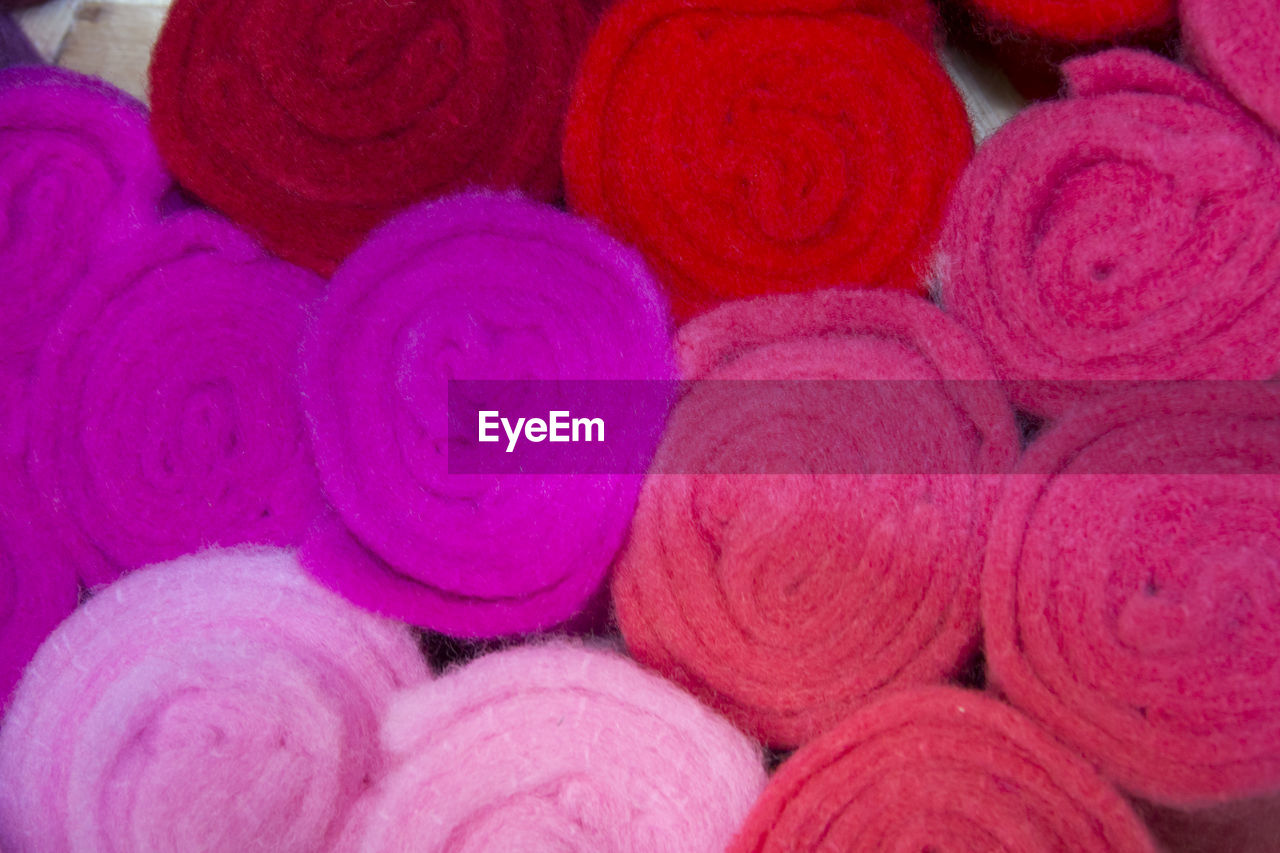full frame, backgrounds, no people, indoors, pink color, multi colored, close-up, day