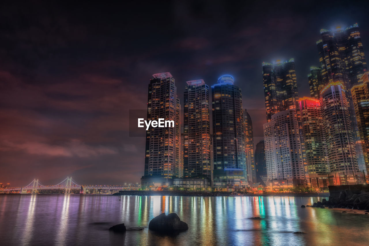 night, illuminated, built structure, architecture, water, building exterior, sky, river, outdoors, no people, cloud - sky, travel destinations, skyscraper, nature, city