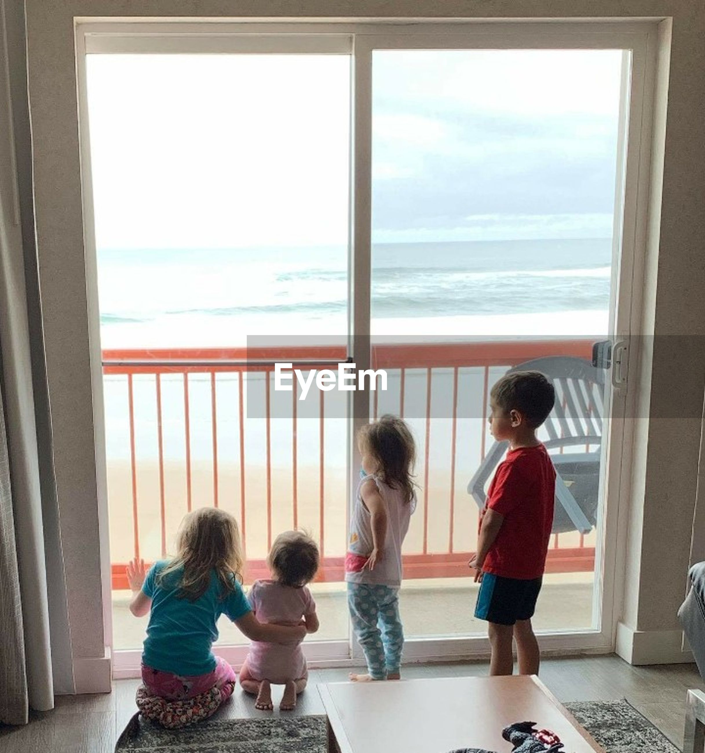 child, childhood, group of people, window, boys, girls, females, women, offspring, family, males, indoors, togetherness, casual clothing, standing, men, sibling, brother, sister