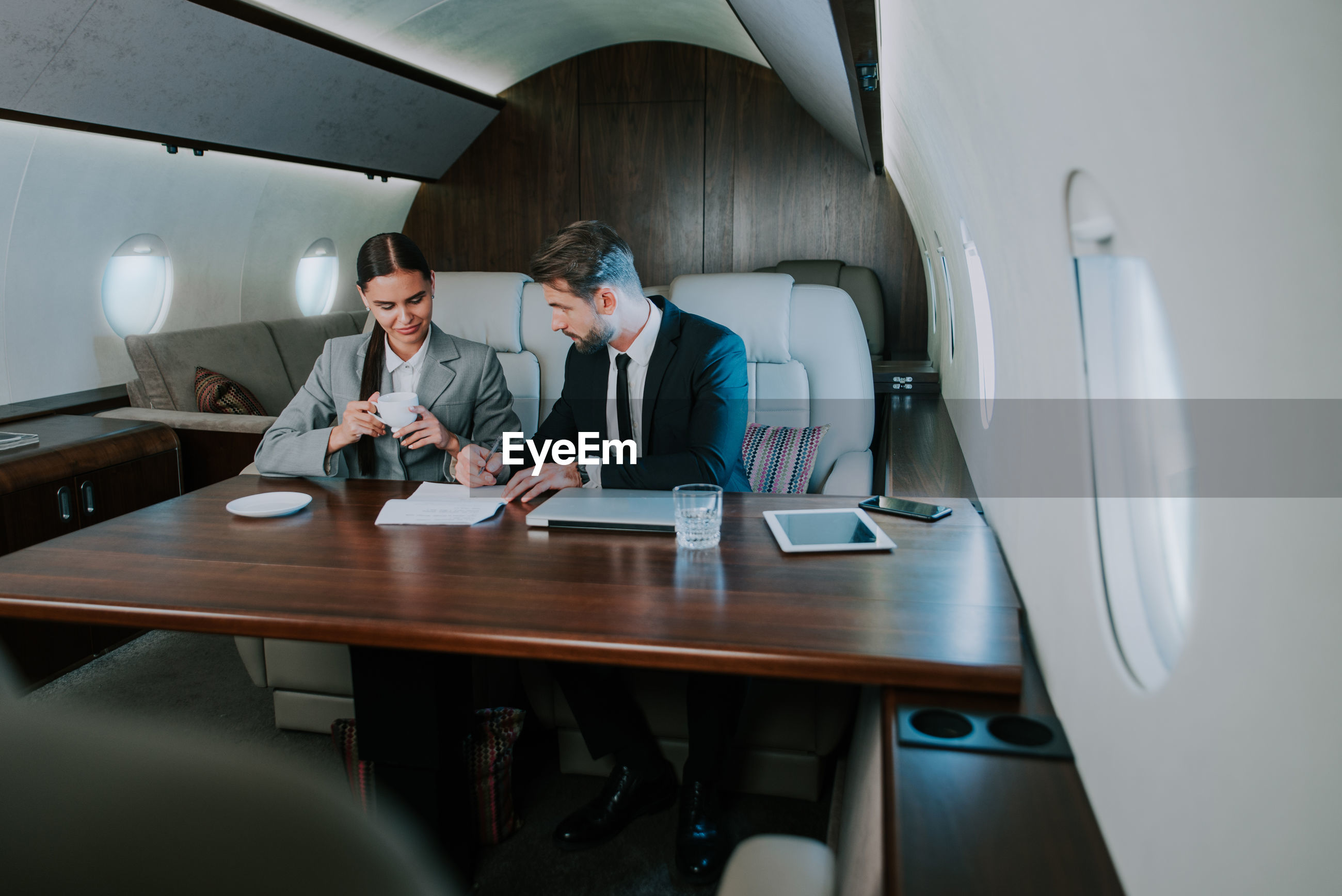 Business person sitting in airplane
