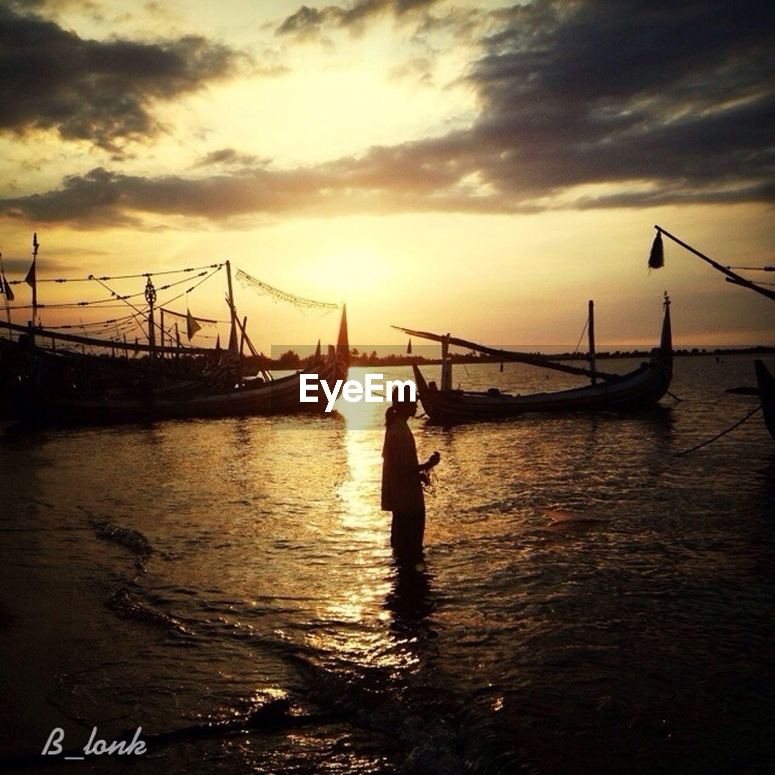 sunset, water, sky, sea, nautical vessel, transportation, silhouette, cloud - sky, orange color, sun, boat, scenics, beauty in nature, pier, nature, tranquility, mode of transport, tranquil scene