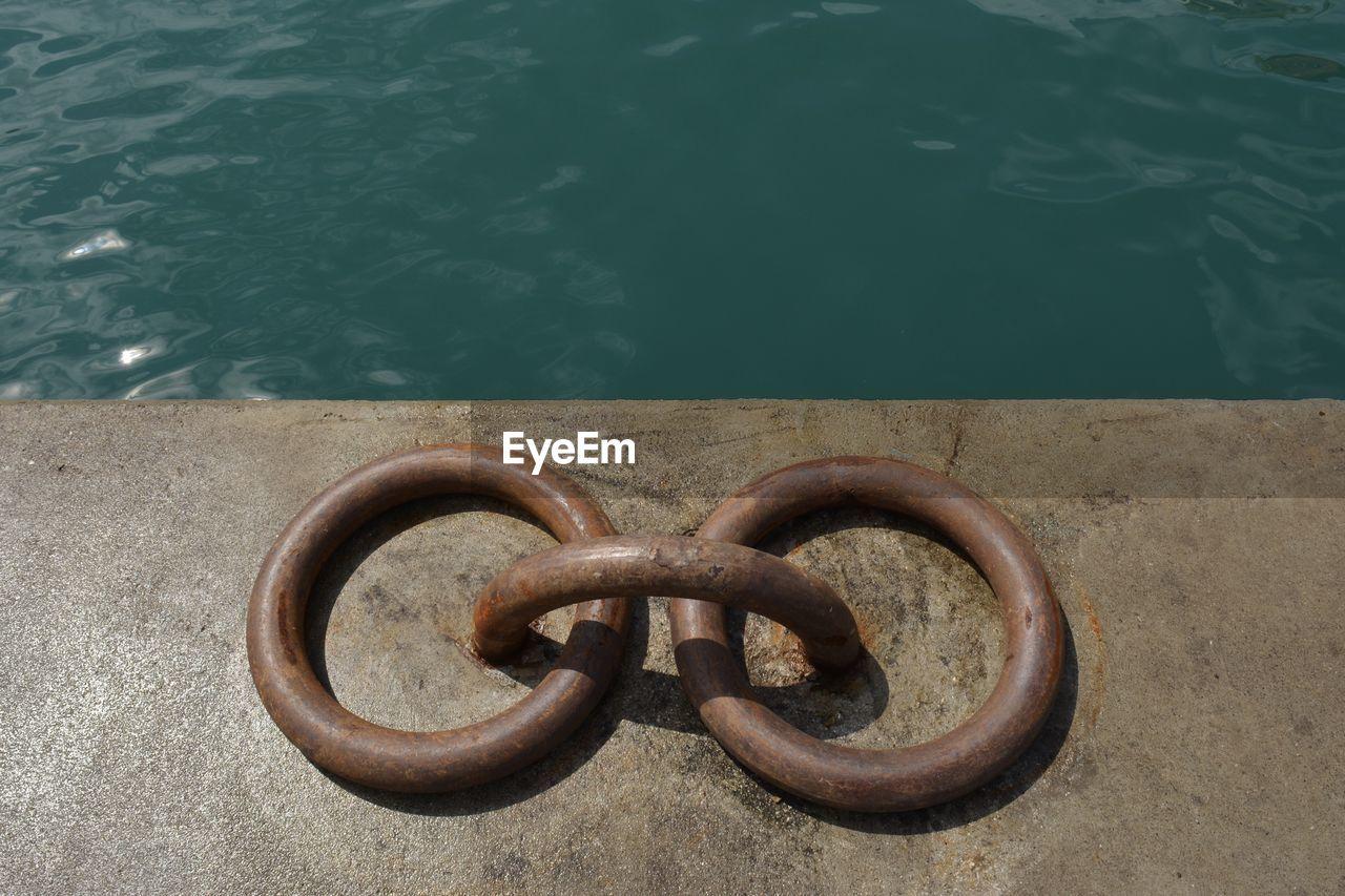 High angle view of mooring rings at pier