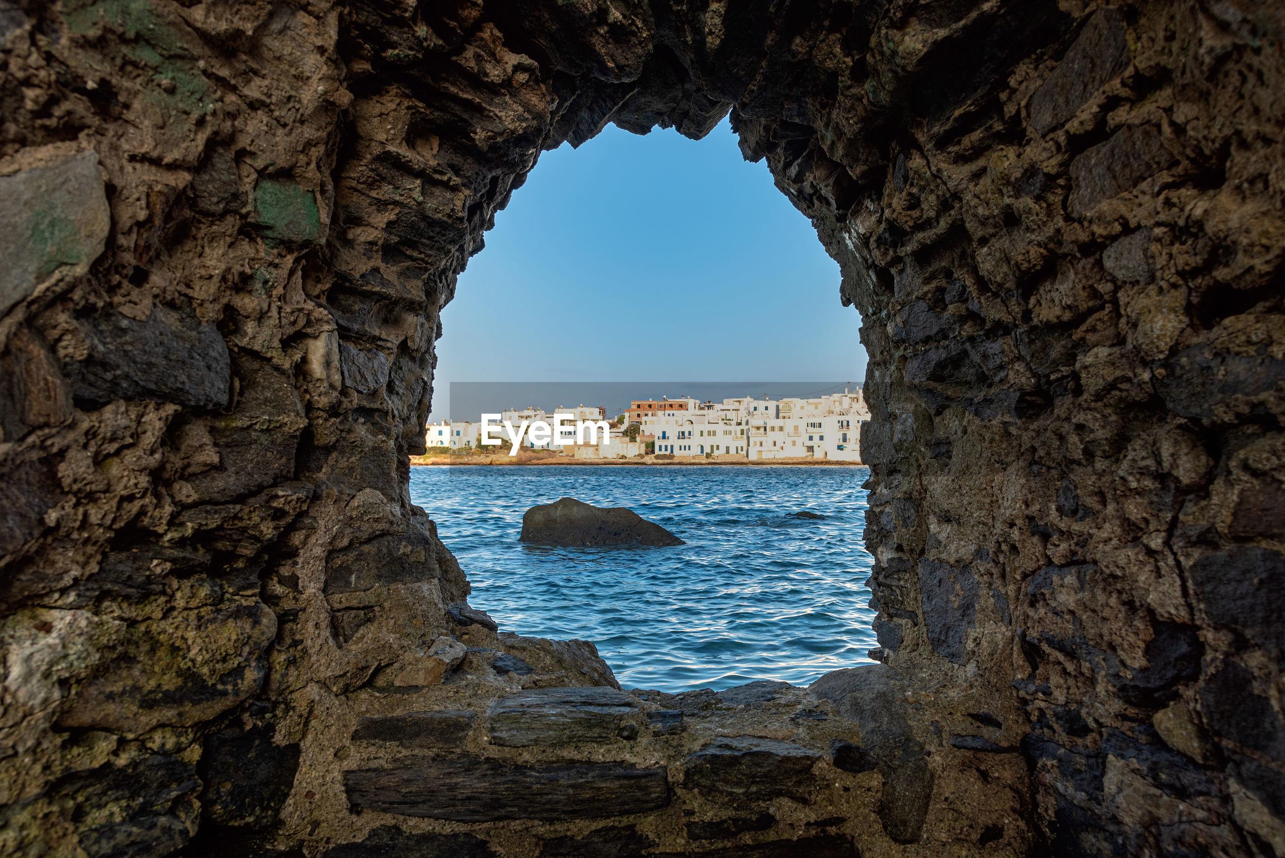 SEA SEEN THROUGH ROCK FORMATION