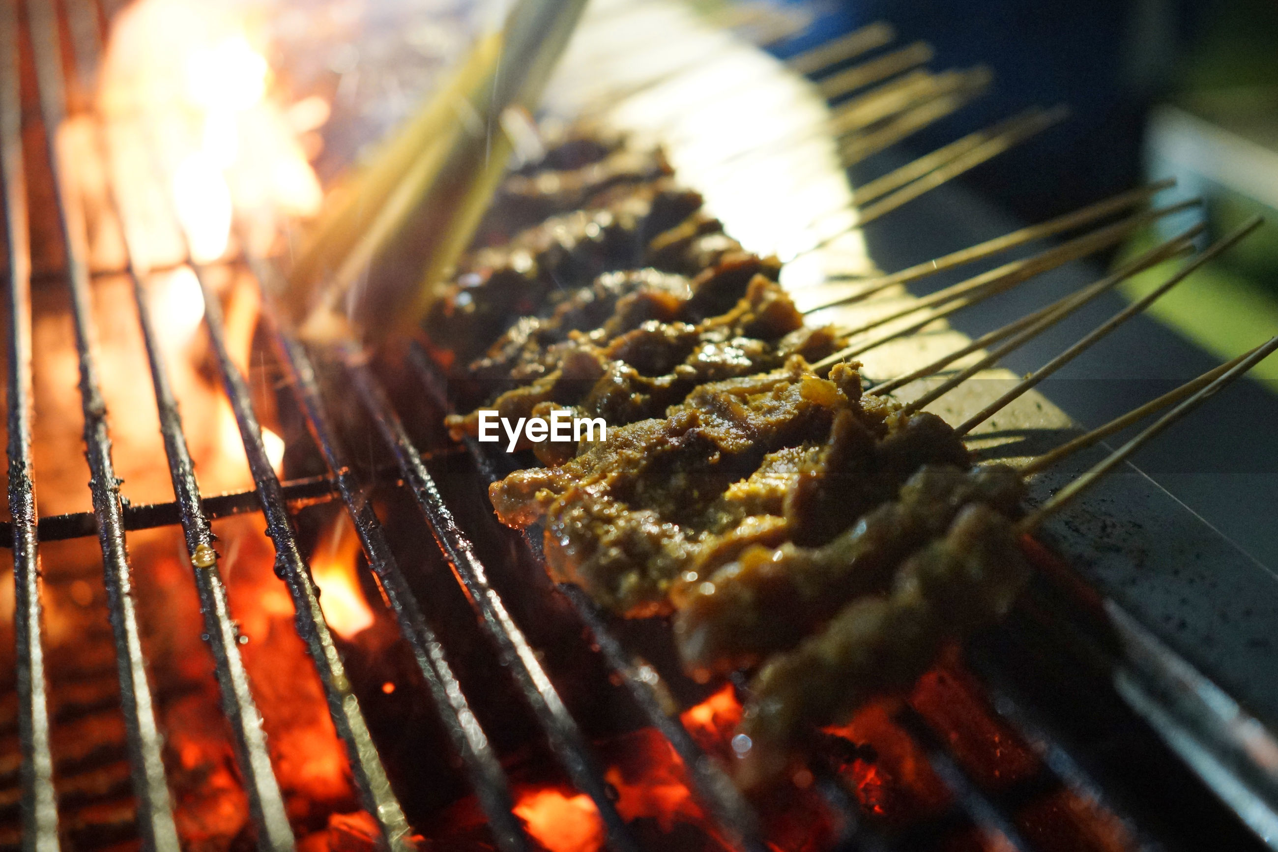 Close-up of meat satay on barbecue grill at market