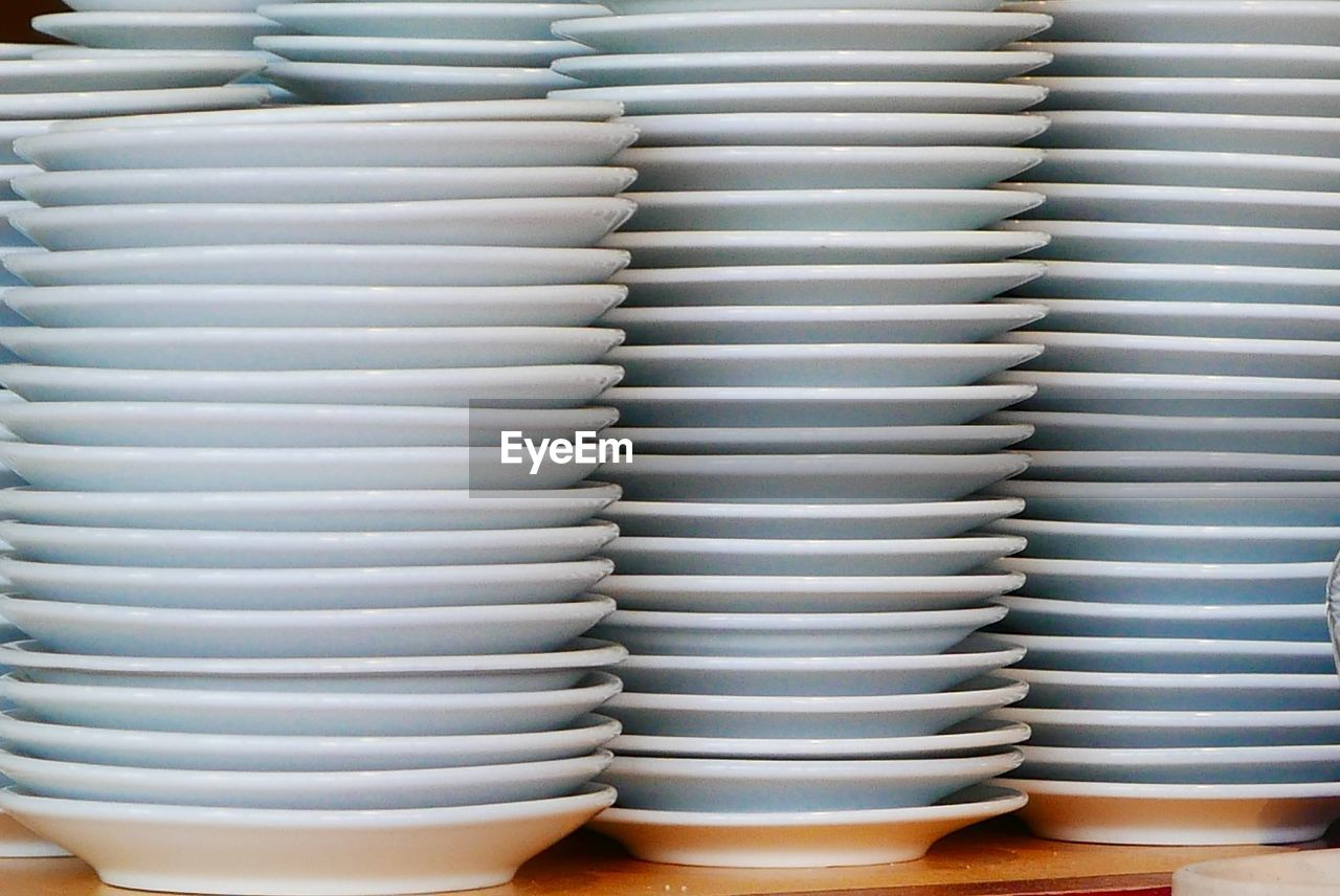 Close-Up Of Stack Of White Plates