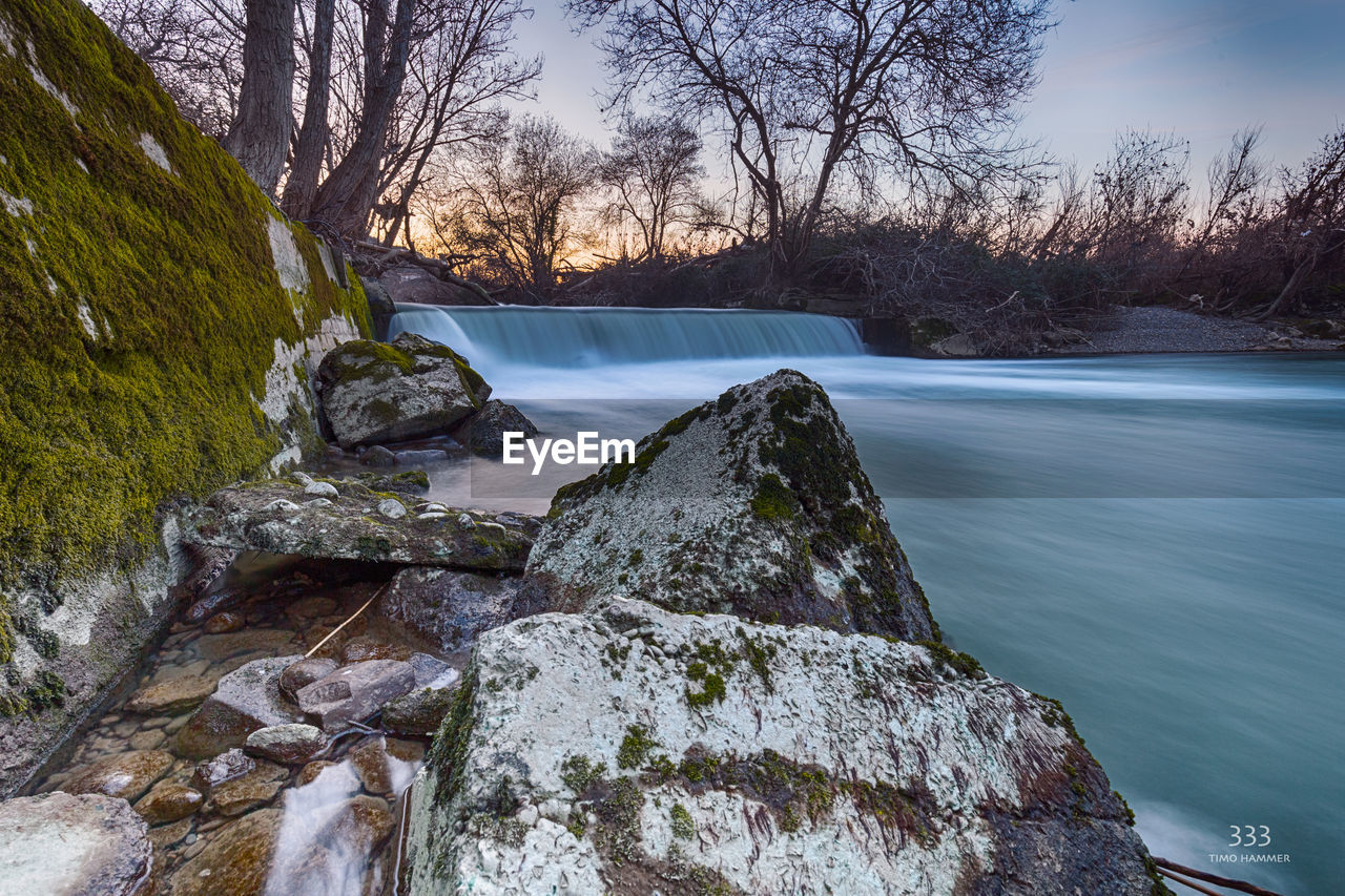 water, nature, scenics, motion, tree, long exposure, beauty in nature, waterfall, river, blurred motion, tranquil scene, no people, outdoors, sky, day