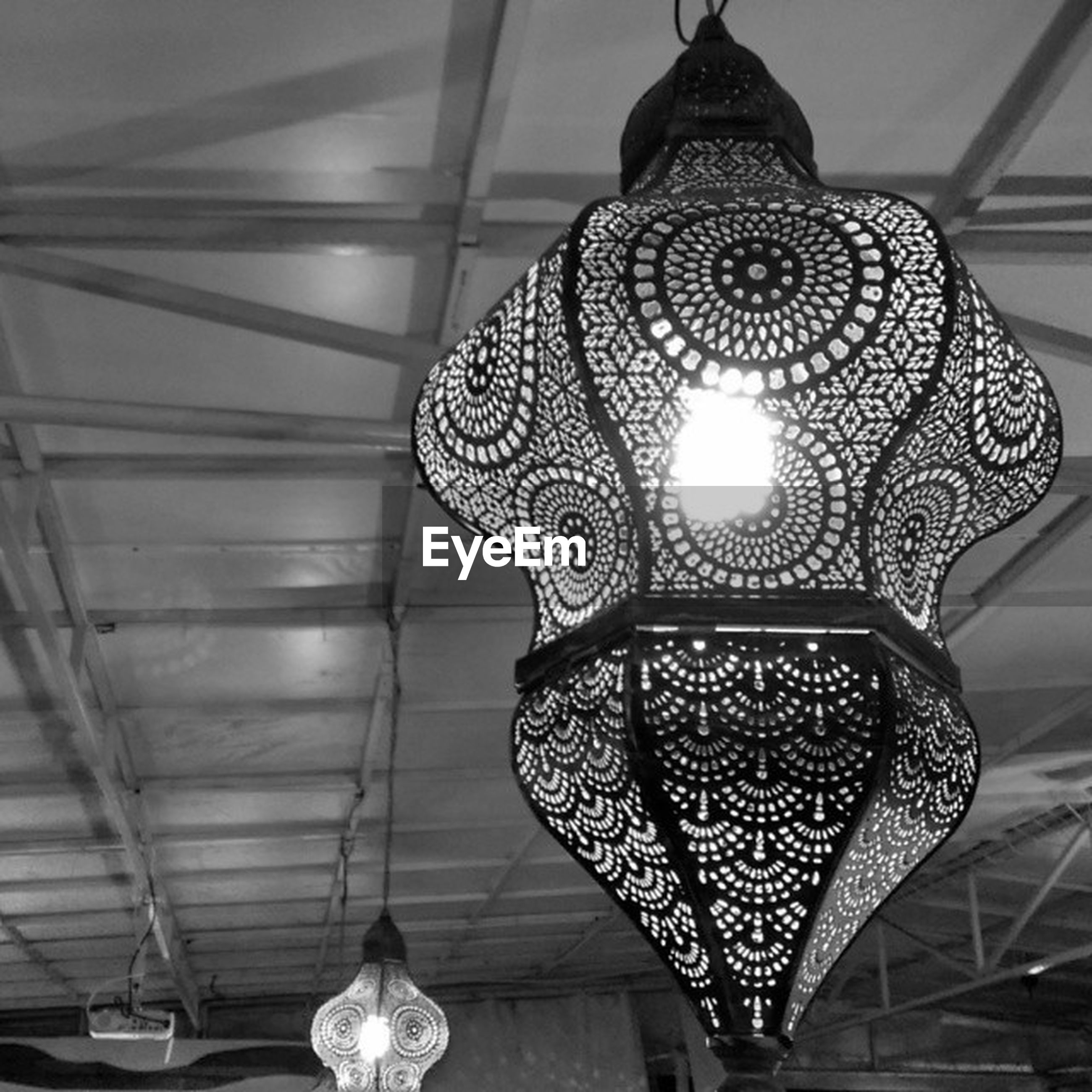 indoors, lighting equipment, hanging, ceiling, illuminated, chandelier, decoration, low angle view, electric lamp, decor, home interior, design, electric light, electricity, pattern, ornate, no people, lamp, lantern, built structure