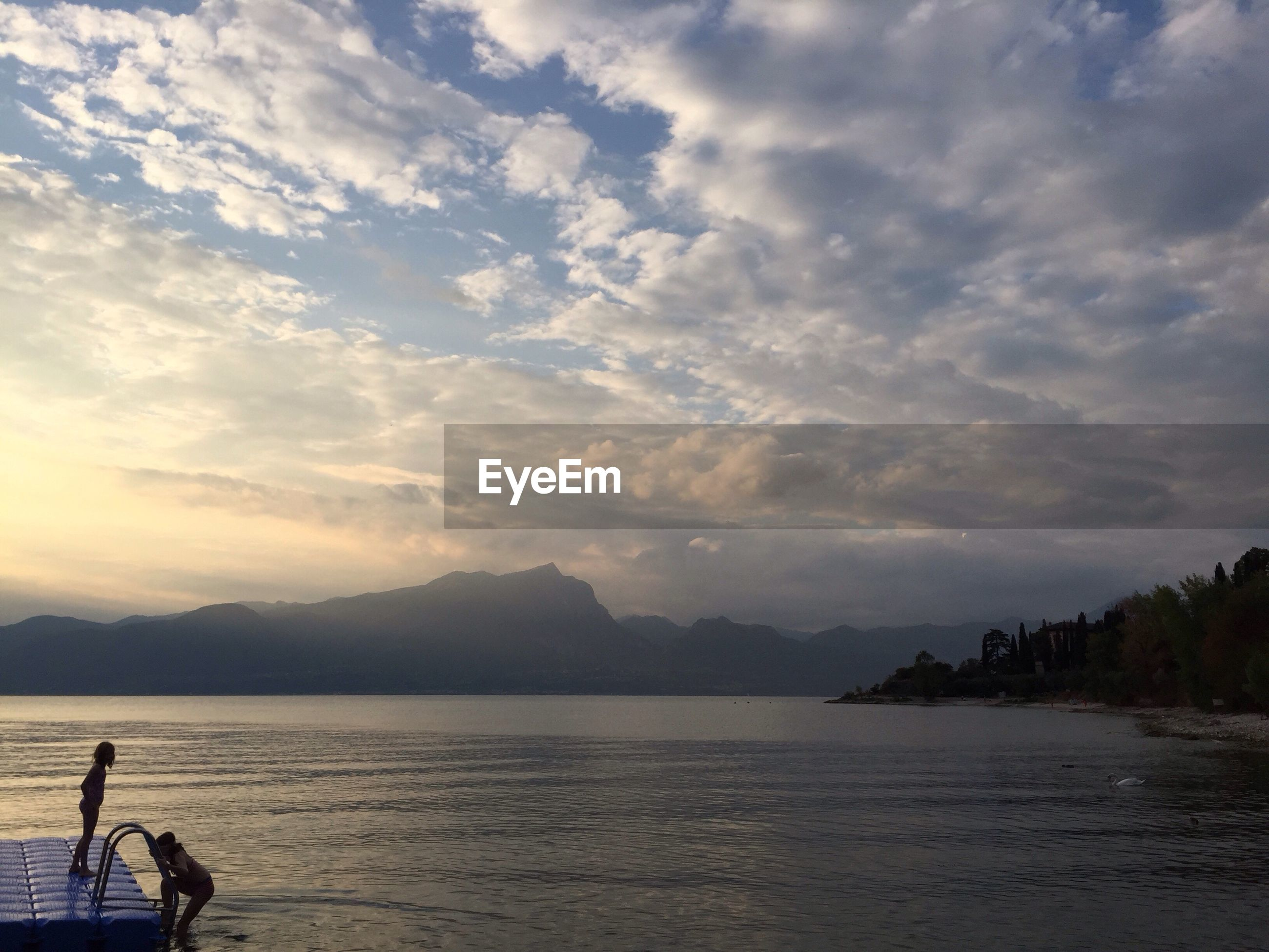 SCENIC VIEW OF SEA WITH MOUNTAIN IN BACKGROUND