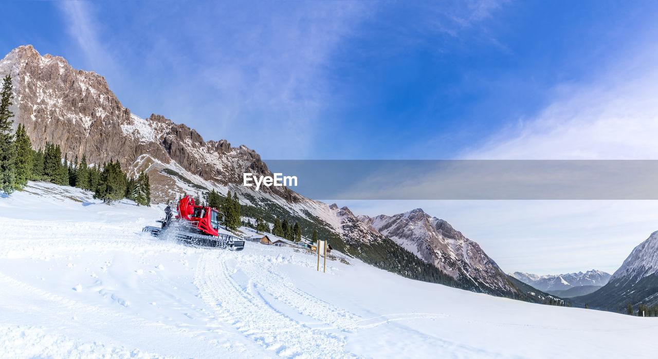 SNOWPLOUGH AT SKI RESORT