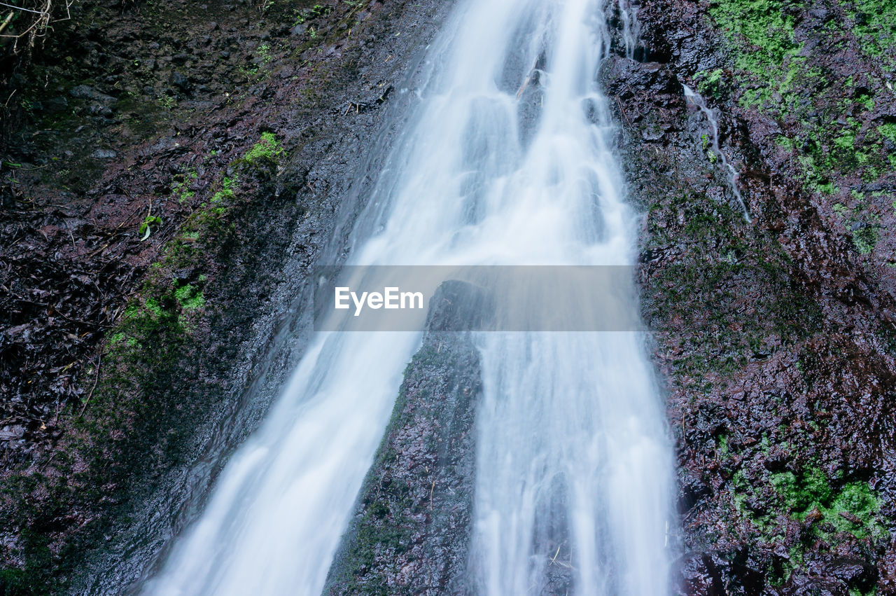 motion, scenics - nature, beauty in nature, blurred motion, water, long exposure, waterfall, forest, land, flowing water, tree, rock, nature, plant, no people, rock - object, day, solid, environment, power in nature, flowing, outdoors, rainforest, falling water