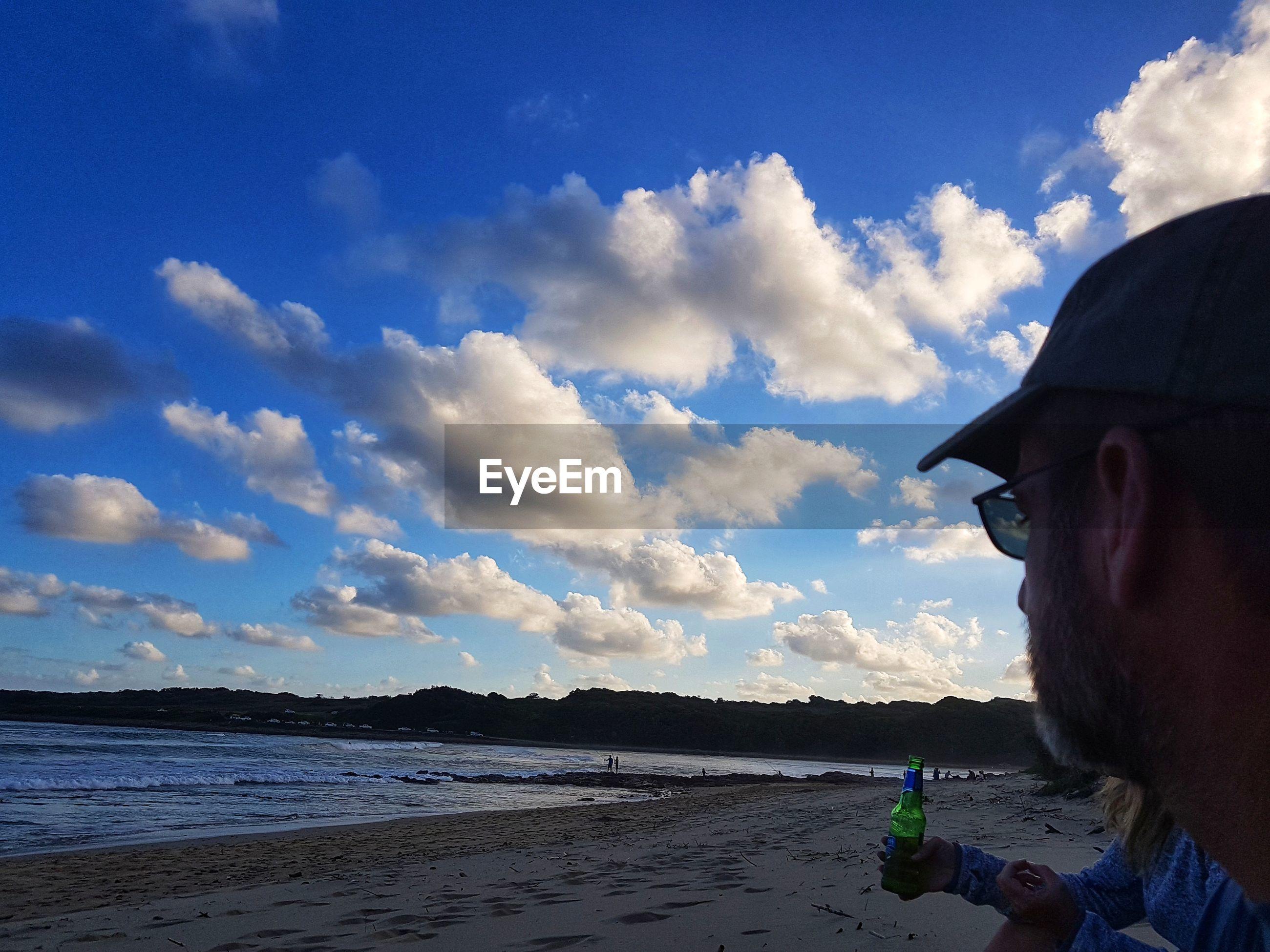 CLOSE-UP OF MAN AT BEACH