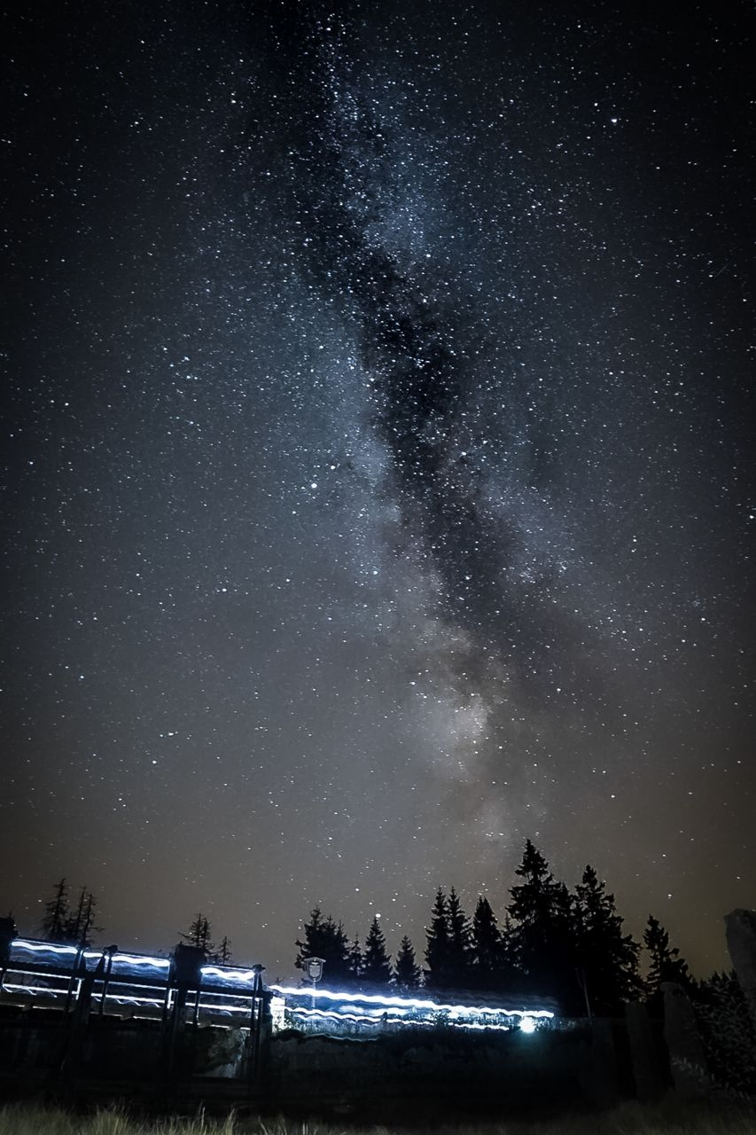 night, astronomy, star - space, sky, space, scenics - nature, galaxy, beauty in nature, tree, tranquility, nature, star, star field, tranquil scene, no people, water, milky way, plant, illuminated, land, outdoors, space and astronomy