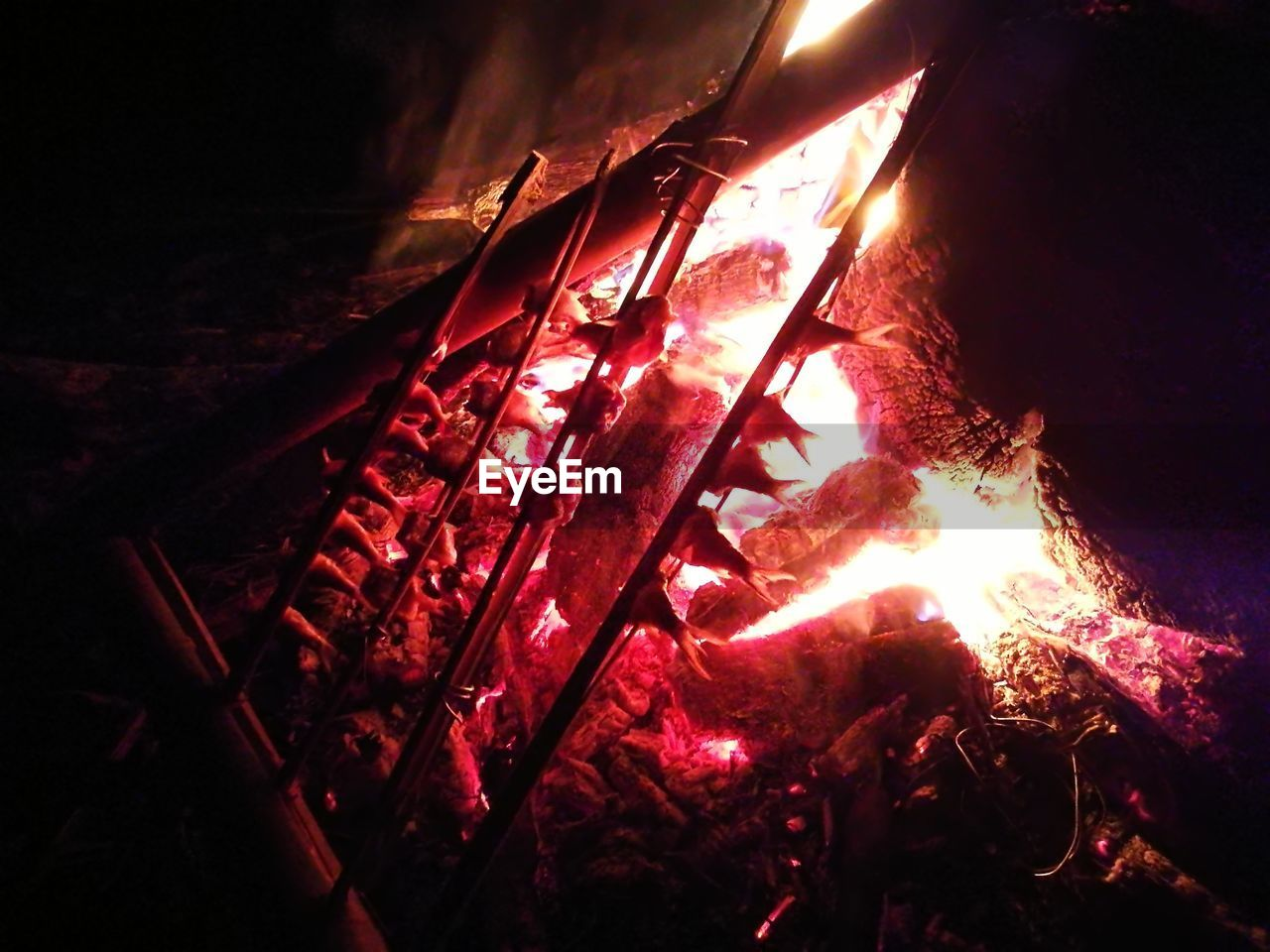 heat - temperature, fire, burning, fire - natural phenomenon, flame, wood - material, night, no people, log, firewood, glowing, wood, indoors, nature, event, bonfire, close-up, high angle view, metal, illuminated, campfire