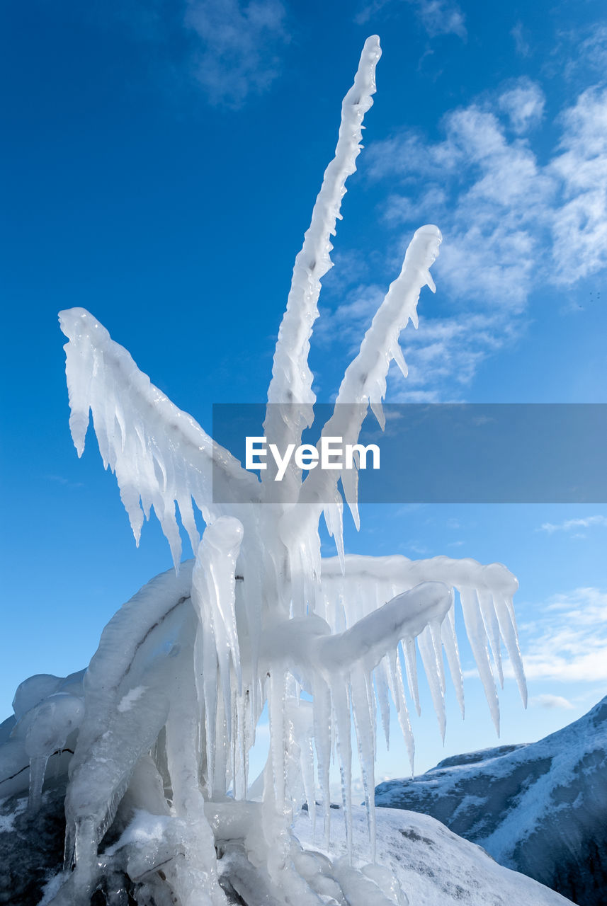 cold temperature, winter, snow, sky, cloud - sky, white color, ice, nature, beauty in nature, environment, frozen, scenics - nature, blue, landscape, day, tranquil scene, tranquility, no people, non-urban scene, icicle, snowcapped mountain