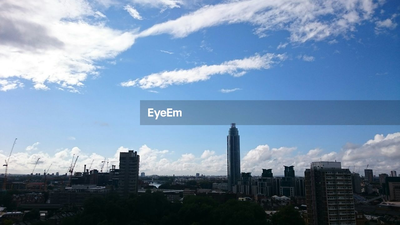 architecture, built structure, building exterior, sky, cityscape, city, cloud - sky, skyscraper, tall - high, travel destinations, tower, day, no people, outdoors, modern, tall, urban skyline