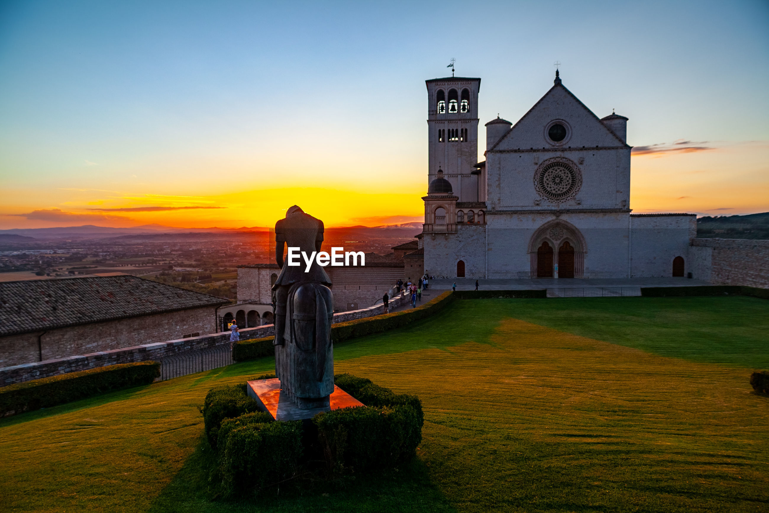 Scenic view of saint francis basilica in assisi, umbria, italy, at sunset