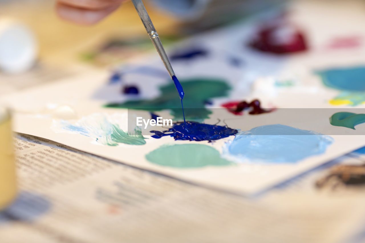 selective focus, creativity, art and craft, paper, indoors, close-up, craft, paint, multi colored, no people, still life, palette, paintbrush, table, skill, art and craft equipment, brush, watercolor paints, textile, choice