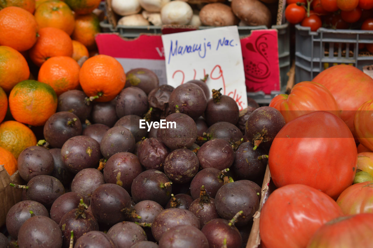 market, price tag, for sale, market stall, food, orange color, abundance, retail, food and drink, vegetable, large group of objects, freshness, text, healthy eating, communication, no people, fruit, day, variation, choice, outdoors, close-up