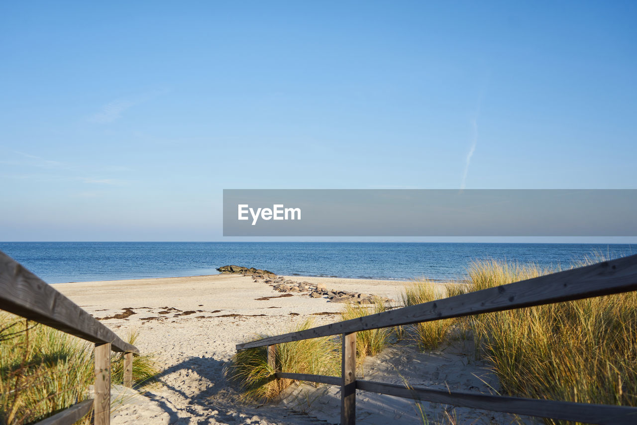 water, sea, sky, horizon, horizon over water, scenics - nature, beauty in nature, tranquil scene, land, nature, tranquility, railing, beach, day, sunlight, no people, non-urban scene, idyllic, remote, outdoors