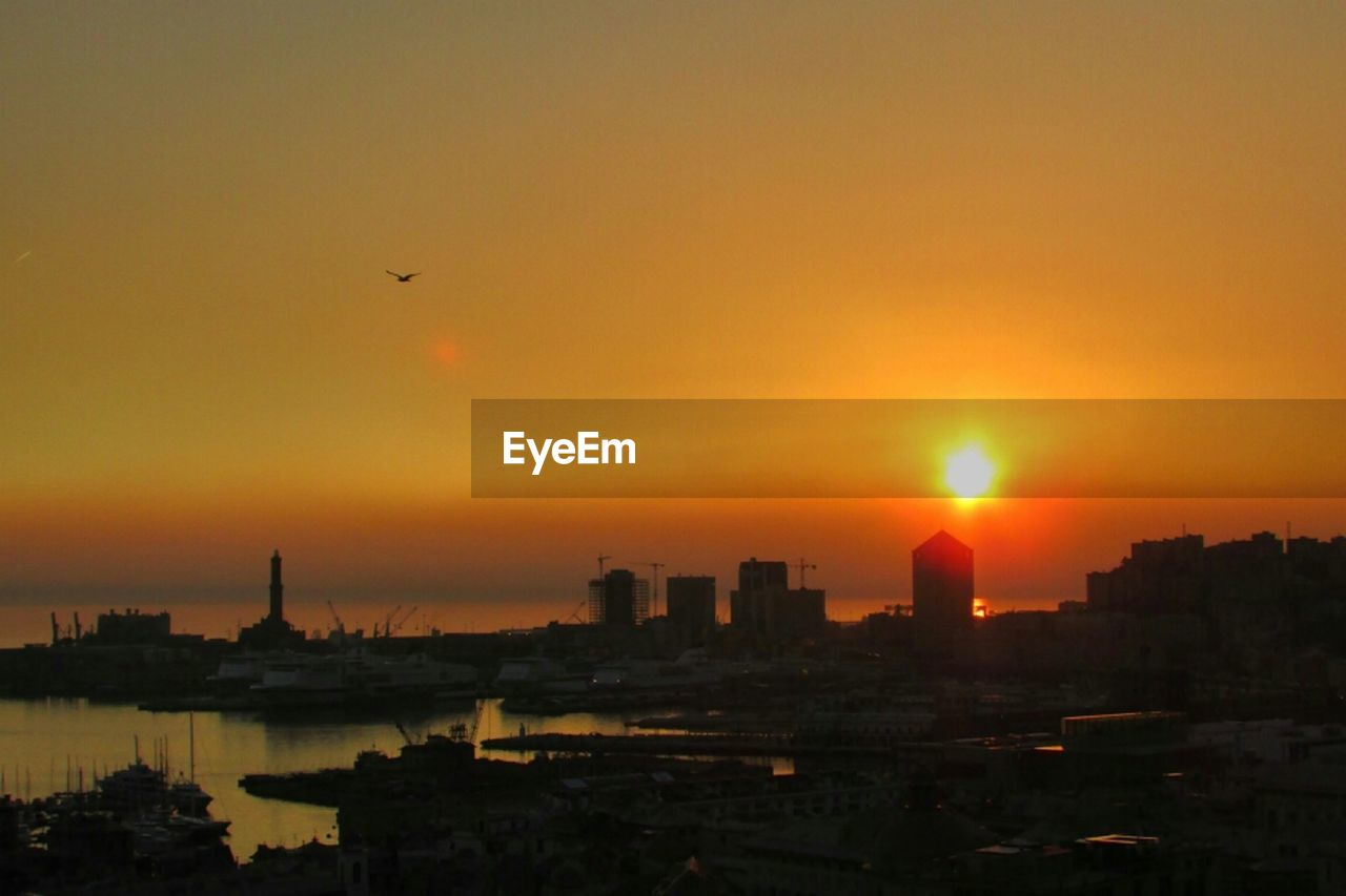 sunset, architecture, building exterior, orange color, built structure, sun, city, cityscape, silhouette, sky, no people, outdoors, travel destinations, skyscraper, nature