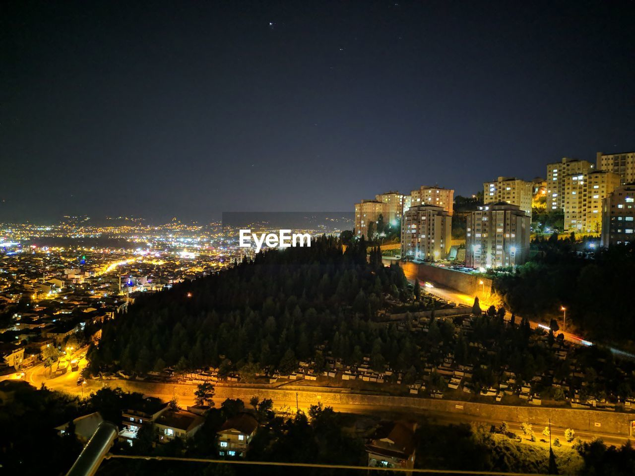 building exterior, illuminated, night, architecture, city, built structure, cityscape, sky, building, no people, high angle view, nature, residential district, outdoors, water, modern, copy space, city life, glowing, office building exterior, skyscraper