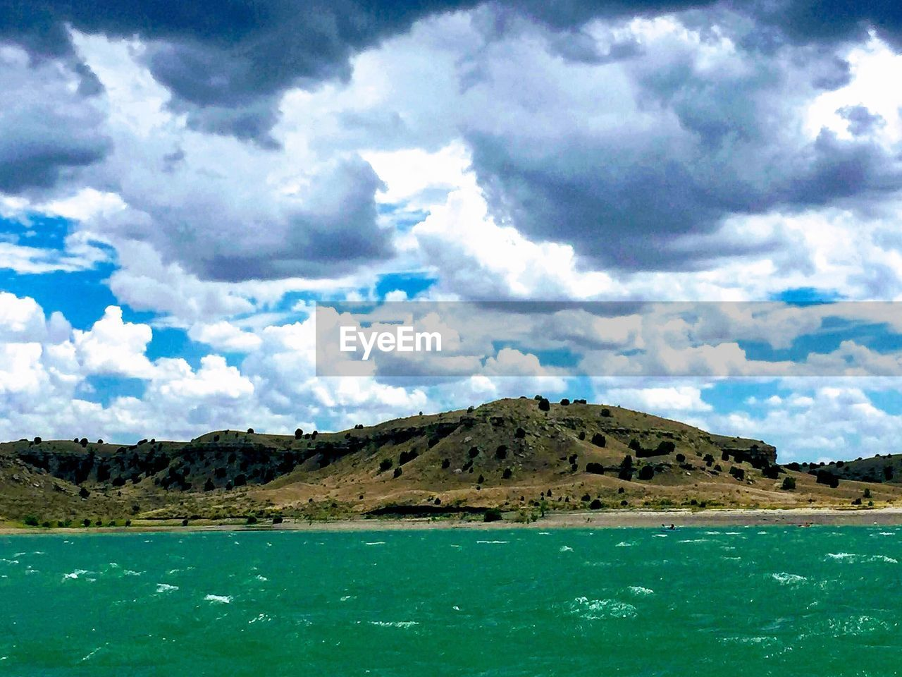 cloud - sky, sky, water, scenics - nature, tranquil scene, beauty in nature, tranquility, mountain, day, nature, no people, waterfront, sea, land, non-urban scene, outdoors, idyllic, environment, beach, turquoise colored