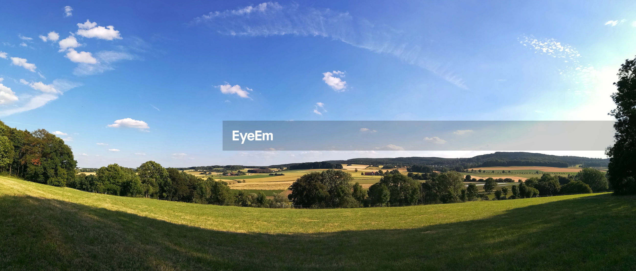 PANORAMIC VIEW OF FIELD AGAINST SKY