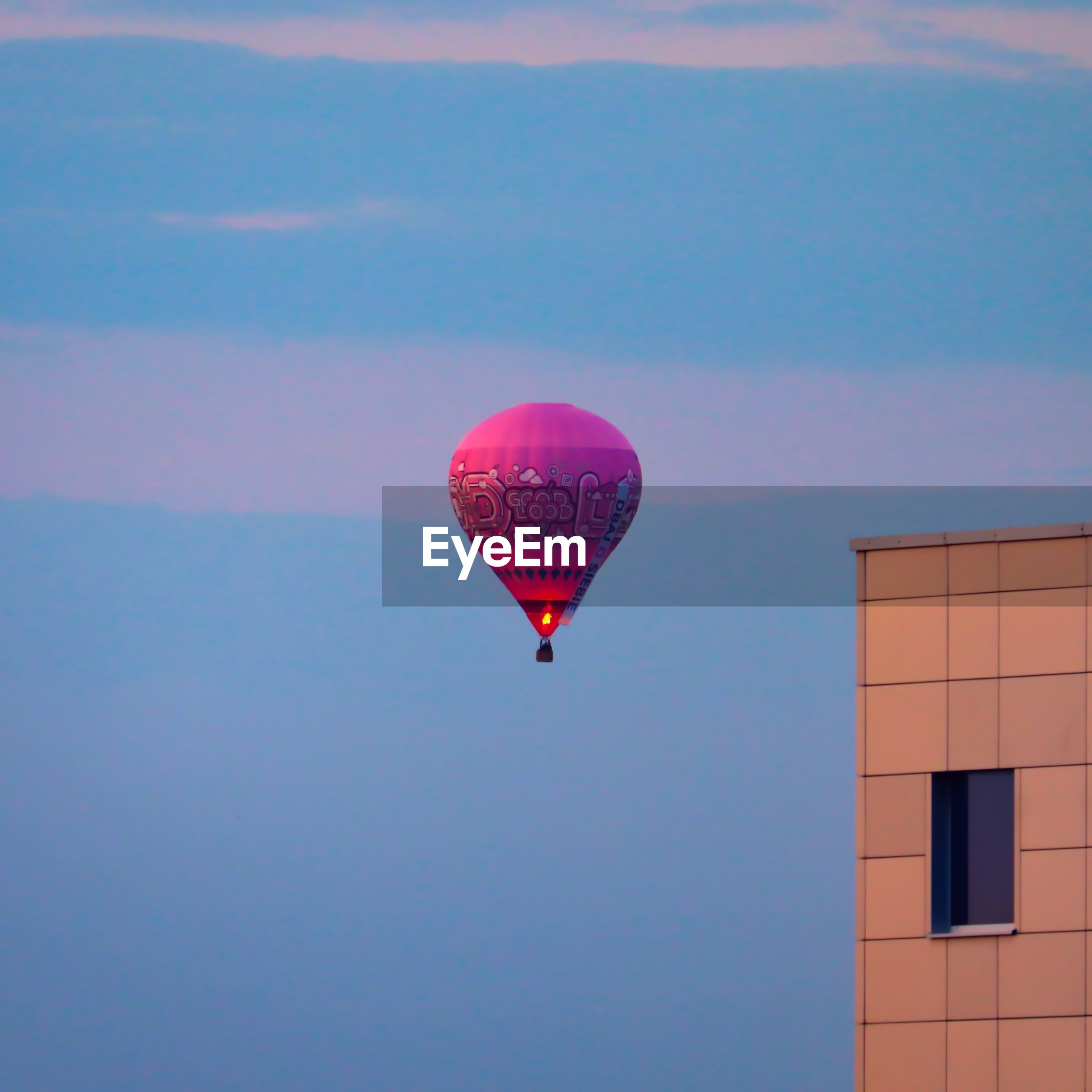 VIEW OF HOT AIR BALLOON FLYING OVER BLUE SKY