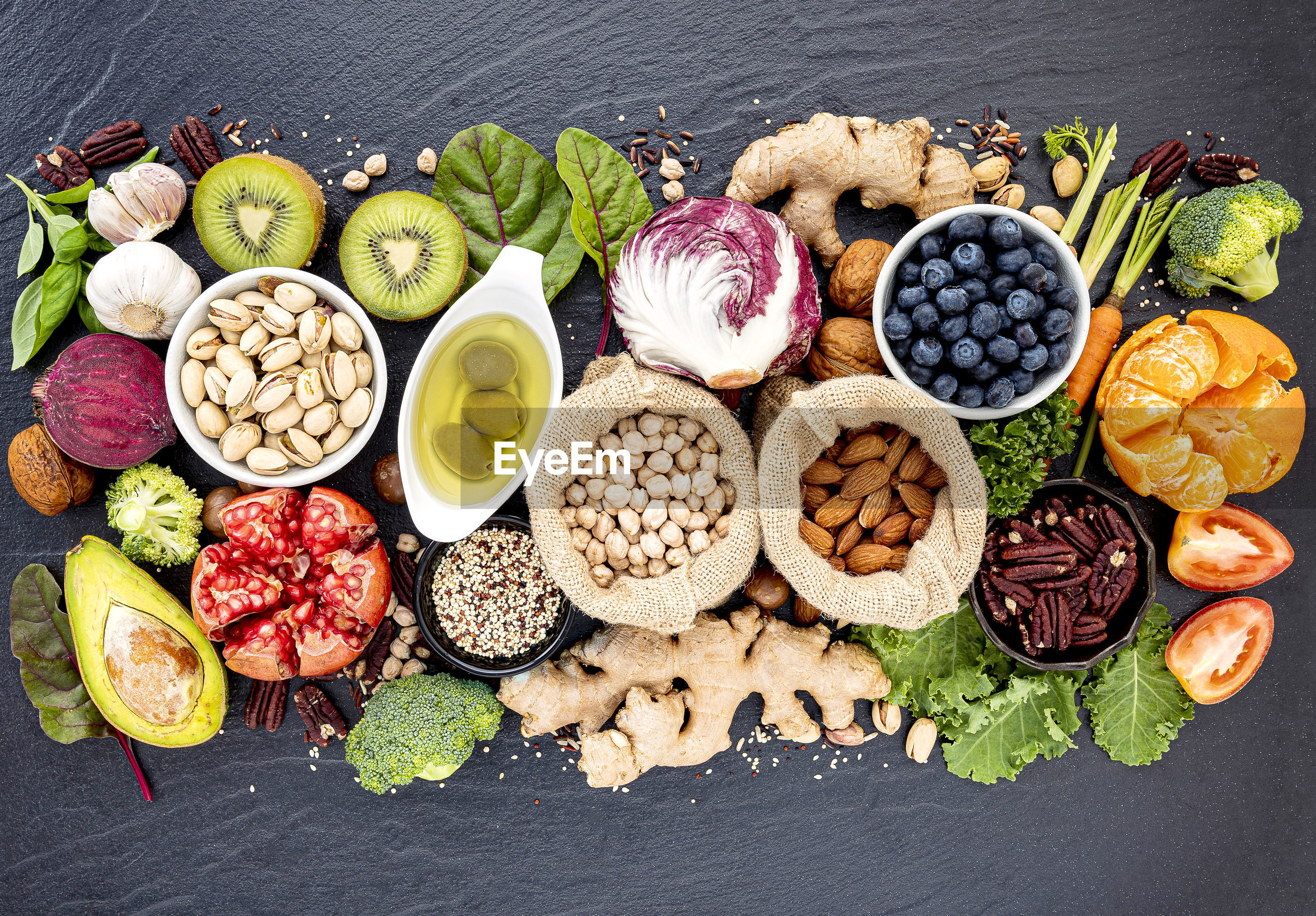 HIGH ANGLE VIEW OF VARIOUS FRUITS IN BOWL WITH VEGETABLES